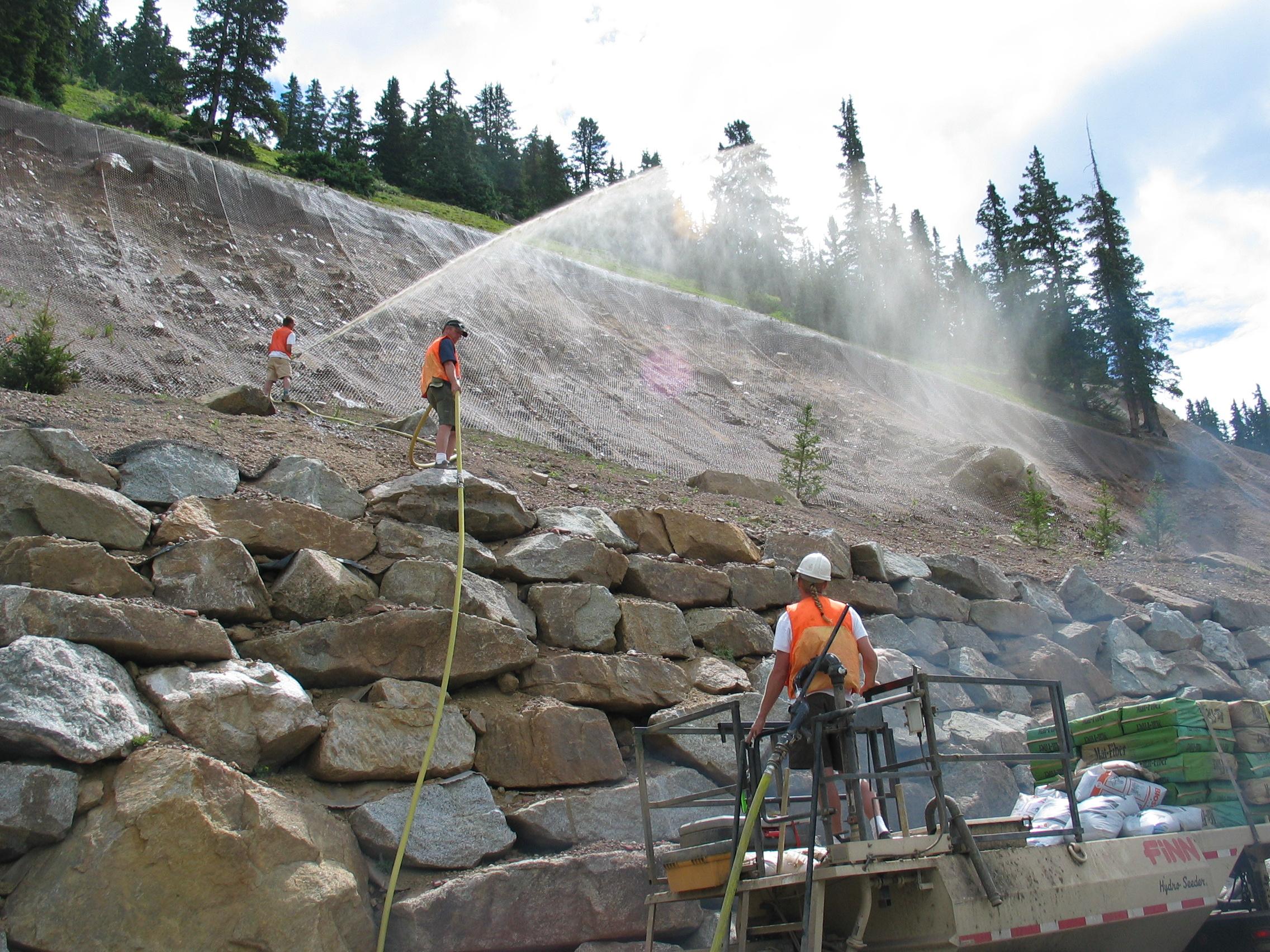 Revegetating and stabilizing the slopes