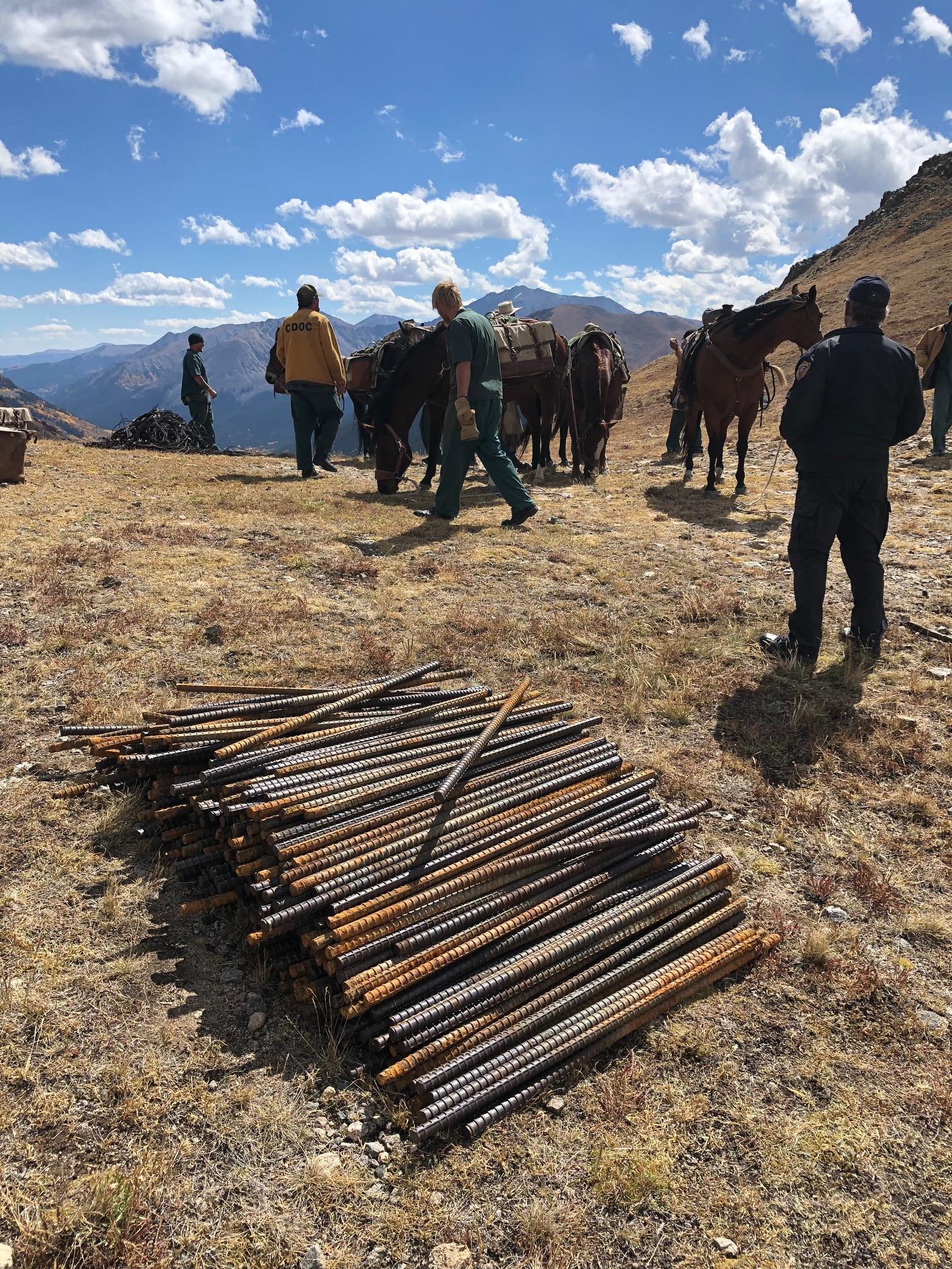 Stack of large rebar awaiting mule-loading, 10lbs per piece