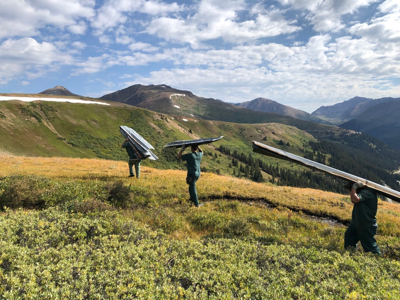 Removing discarded snow fence—12' aluminum panels—from the Mountain Boy area of the Collegiate Peaks Wilderness