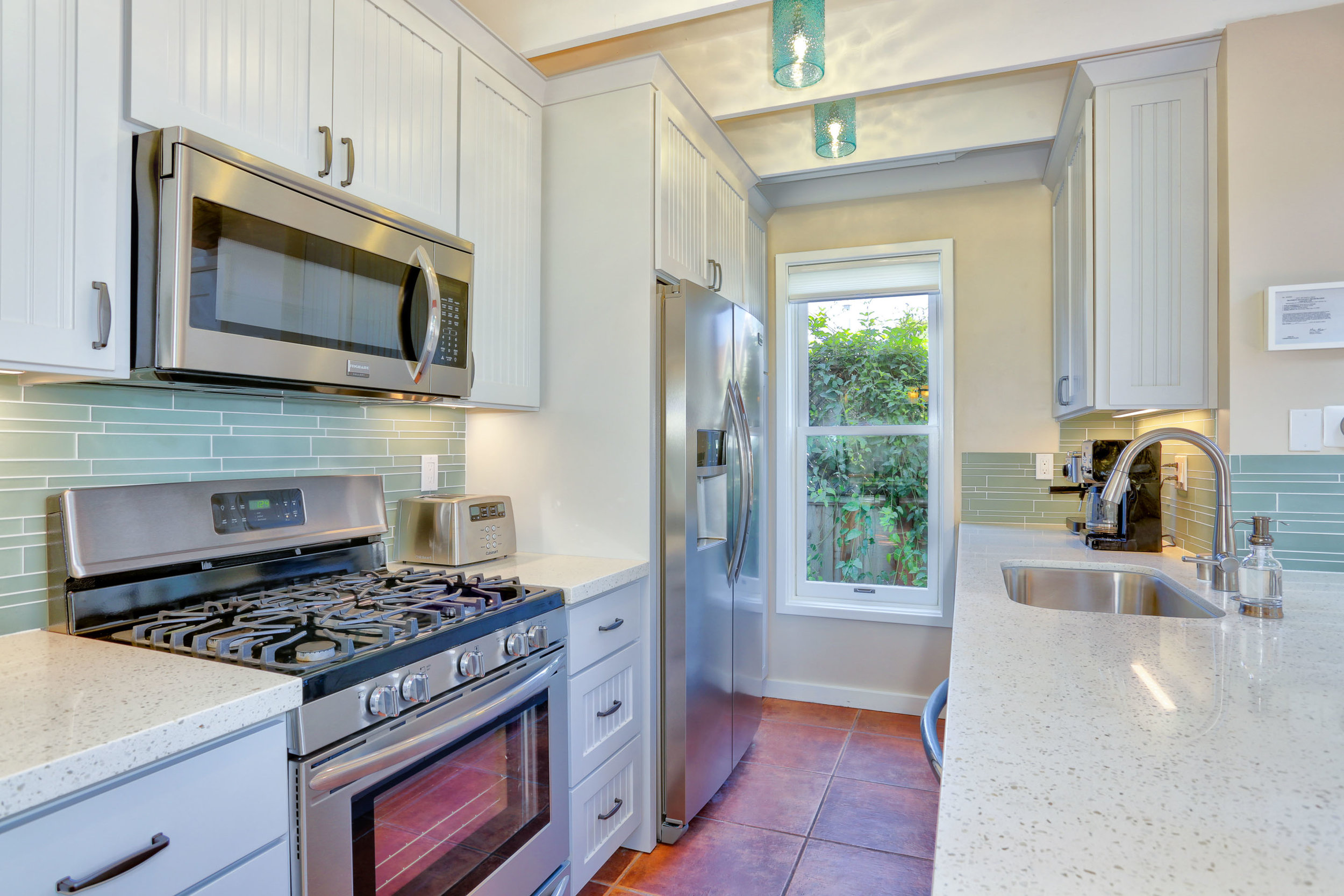 NEW: Brand new kitchen also includes coastal blue back splash to complete the beach house look.
