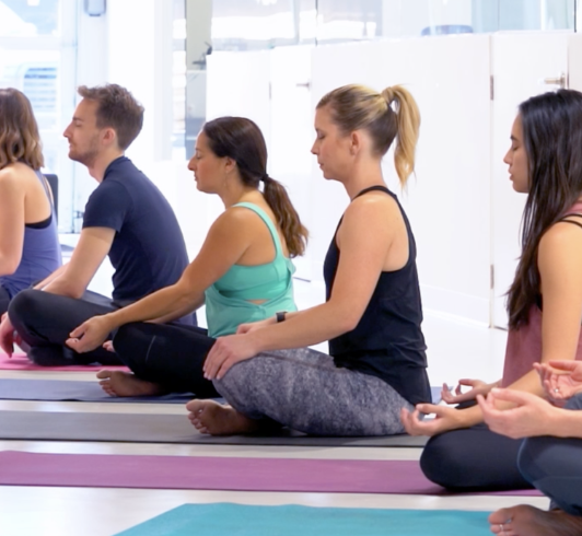 Yoga or meditation at the office is great for focus, stress & team building.    Photo courtesy of Goomi Group.