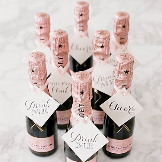 "These mini Moet & Chandon Rose Champaign bottles which say ""drink me"" and ""cheers"" are the cutest wedding favors! What do you all think?  photo via  @lesleemitchell  @jenniferlongeats #InstagramTakeover #BostonUniversity #BUhospitality #inspirationiseverywhere #eventdesign #eventplanning #inspoeverywherebu"