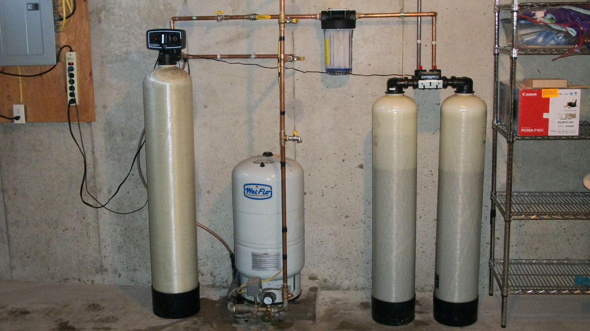 Basic backwashing filter and twin tank arsenic treatment system