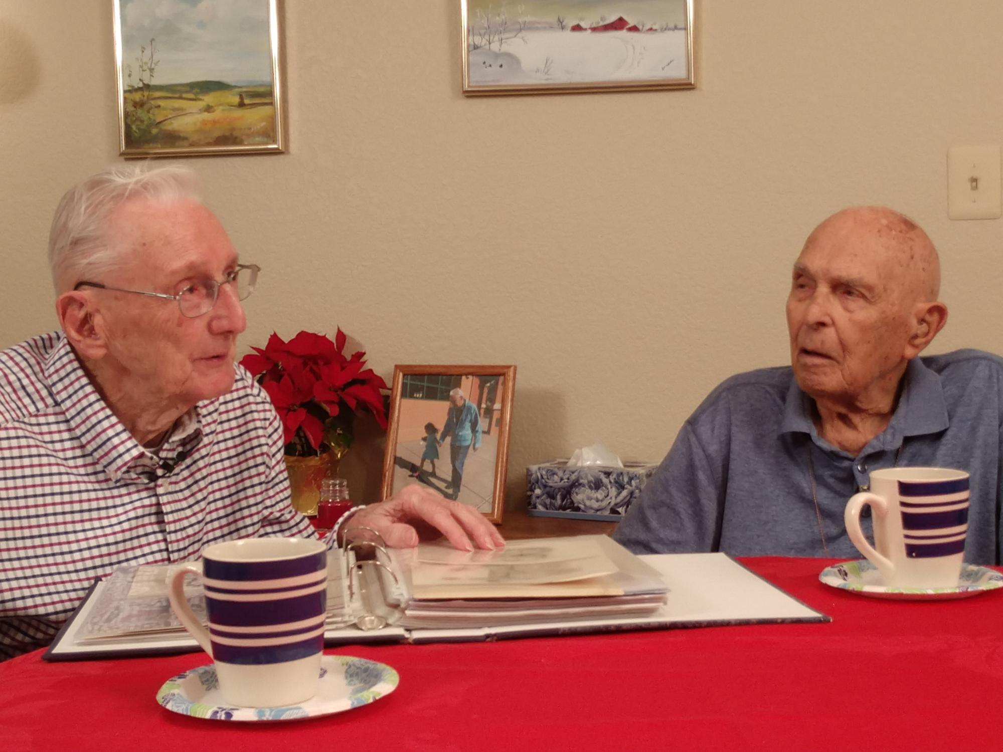 """2LT robert mcadam, 97, and sherwin """"butch"""" desens, 95, reminisce about their time at stalag luft one in germany."""