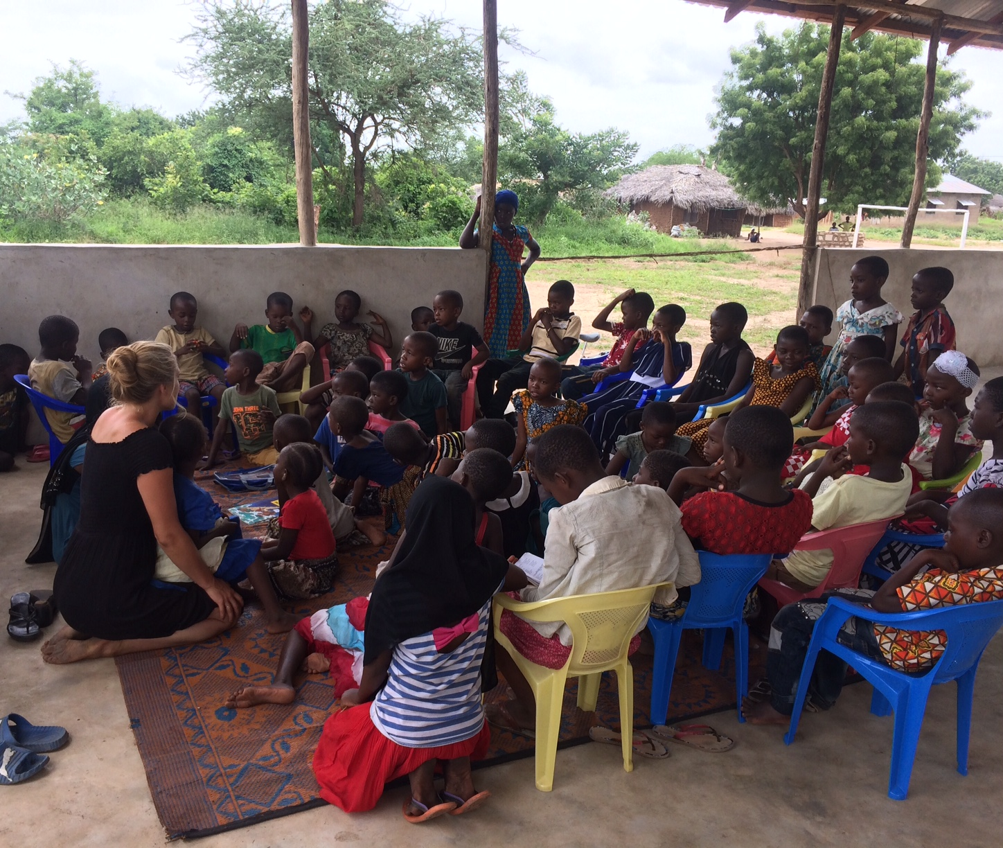 Children piled together for our ever-growing sunday school class, where many children are first hearing about the good news and the hope found in Jesus.