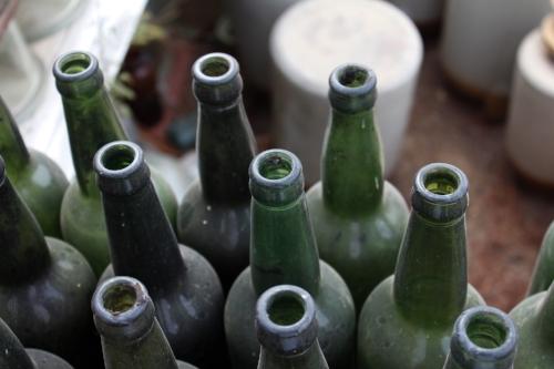 Empty dusty green wine bottles