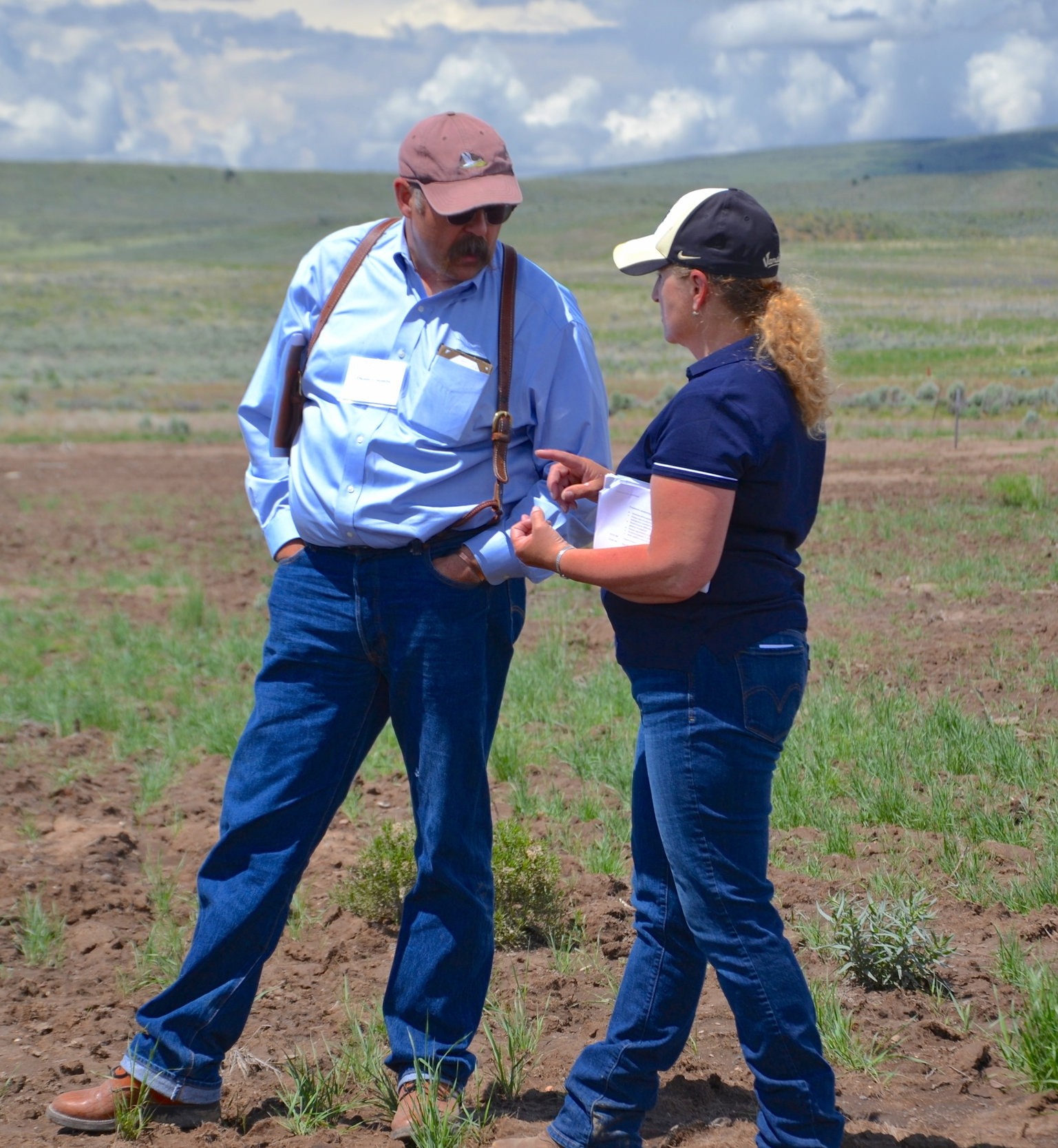 Duane Coombs, Outcome-based Grazing Program Coordinator, and Brenda Richards, IRCP Coordinator, talk about fire and invasives while on a tour of the Soda Fire burn scar.