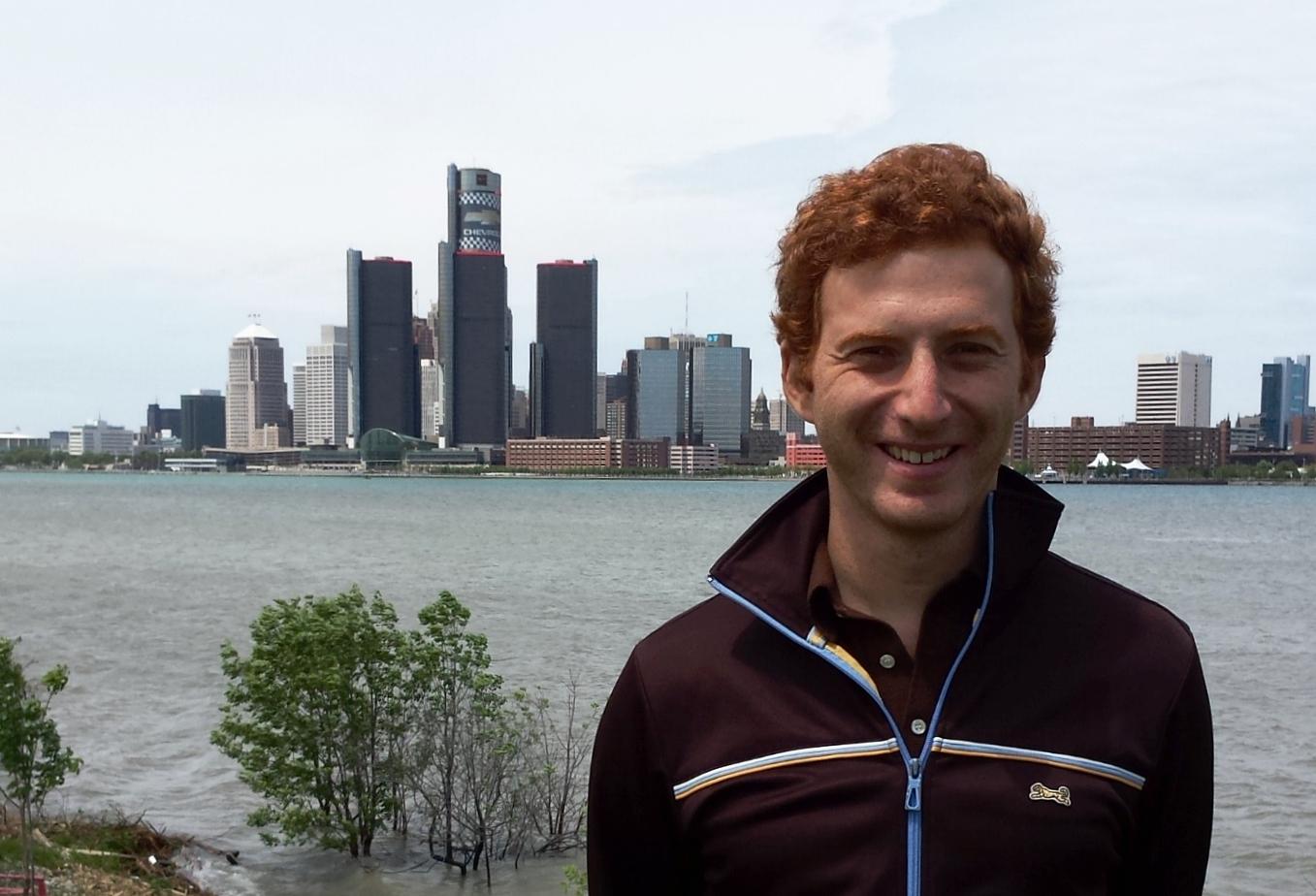 Journalist Ryan Goldberg, photographed against the Detroit skyline