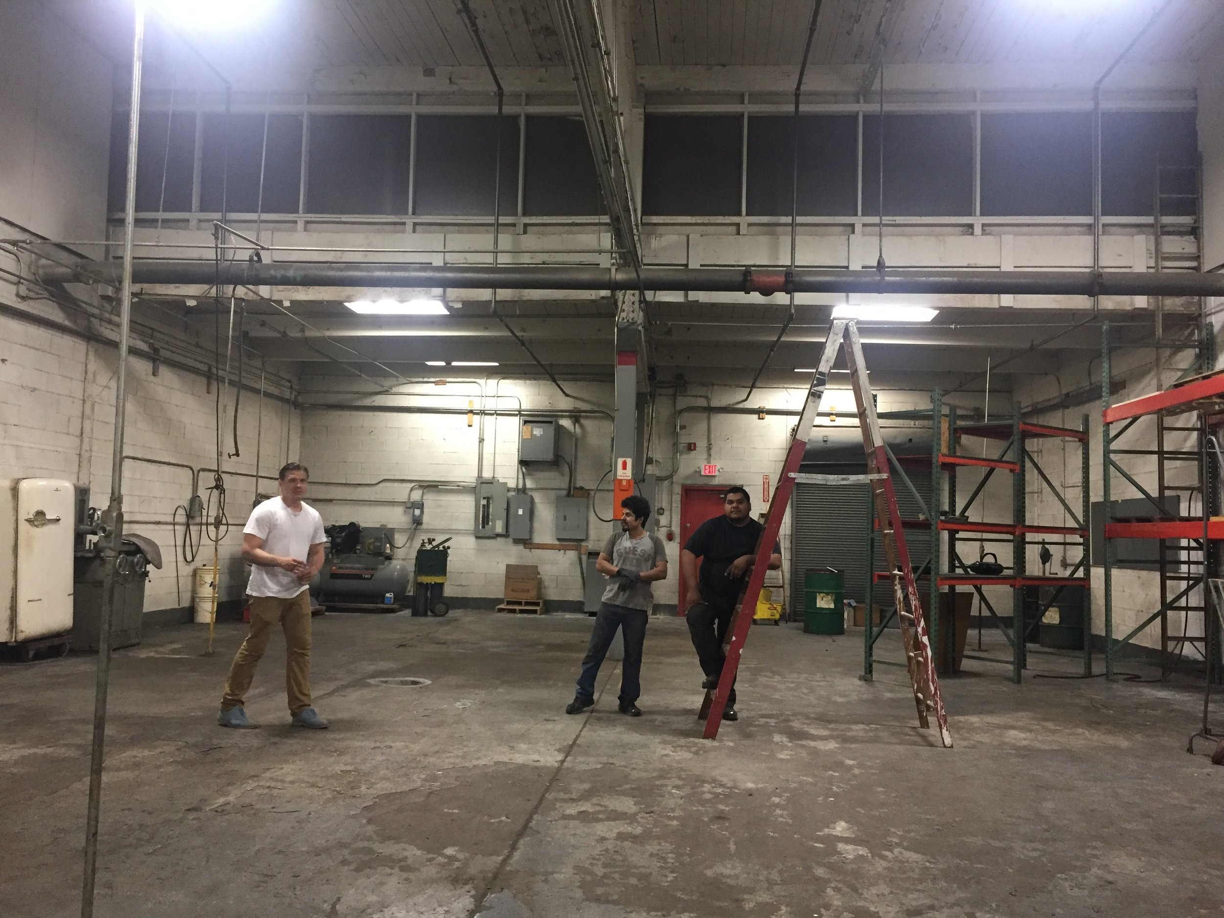 Dan, Jesus and Edgar inspect the new space after finishing cleaning.