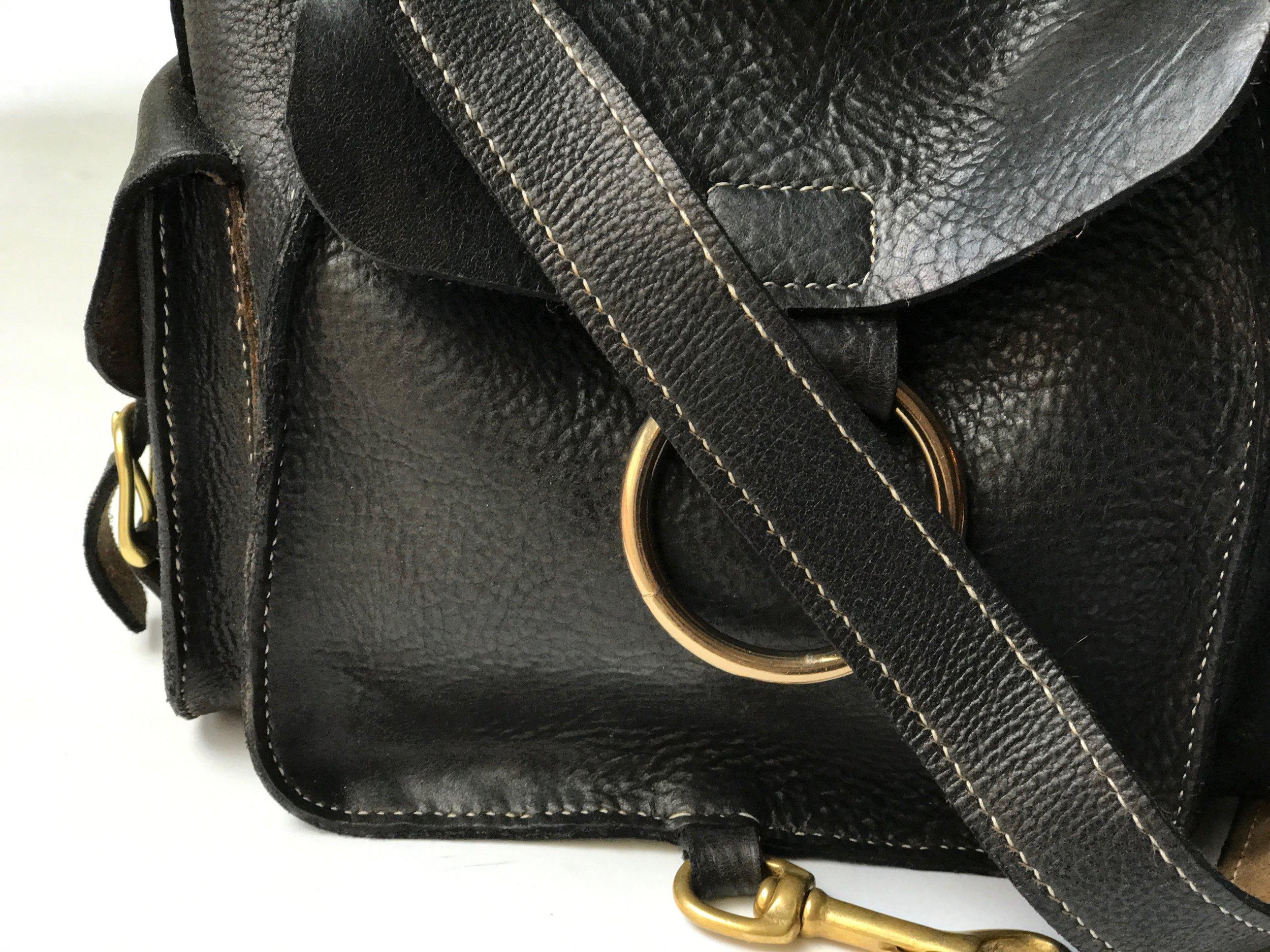 traditional leatherwork, saddle-stitched leather goods, leather handbag