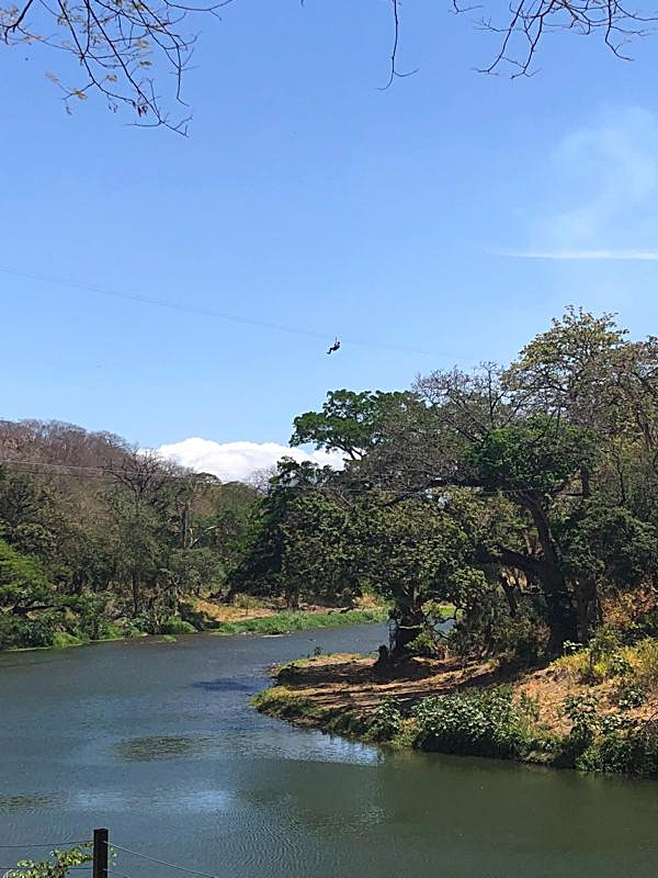 Zip lining across the Tempisque River