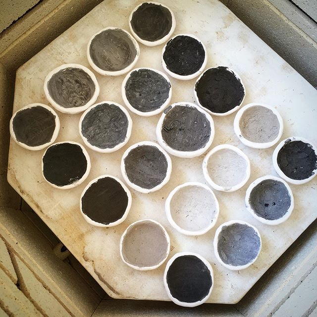 "This may not look like much yet, but these are glaze tests for the fireweed chalices I am making! (Before firing.) Each sample of ash was sent to me by a survivor of a horrible forest fire who gathered the ashes from their burned properties. The finished glazes will go on handmade art pieces customized to each recipient as a meaningful gift and new heirloom. Creating an ash glaze is more alchemy than art, as the properties of each vary drastically! I want to keep as much ash as possible in each formulation, so I begin by mixing the ash with 3 other ingredients and also do one of just the ash itself. Often ash requires a ""flux"" (something that lowers its melting temperature to become smooth and glassy at the temperature I fire to) and others require stabilizers (which help the glaze adhere to the vessel and not run off too much.) I am very excited to fire these initial tests tomorrow and then see what textures, colors, and other properties these glazes yield. ✨ Opening the kiln after an experimental firing like this is like opening a surprise gift. When everything is an experiment, everything is fascinating 😍 . ✨✨✨ . #ashglazetests #misswondersmith #thefireweedproject #makingashglazes #kilnmagic #behindthescenes #artisticprocess #potsinaction #experiment"
