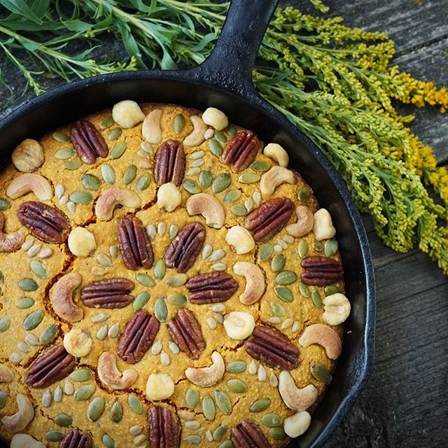 "With harvest season just around the corner (and celebrations like Lammas sneaking up fast!) it's time to celebrate the bounty of our gardens, fields, and wild places! I'm particularly fond of this goldenrod cornbread - it has a bright orange interior color, herbaceous flavor, and beautiful presentation for a feast or a supper. Goldenrod has been beloved by many cultures all over the world for its positive effects on the mood, as if it just can't help but soak up some of that cheery summertime sunshine to share with your spirit. Add a little honey and butter on top and you've got a feast. You can find the recipe on my blog (link in profile) by searching ""goldenrod."" Happy Lammas/Harvest! P.S. I'll be sharing a lovely little secret later this evening, so stay tuned ;) . ✨✨✨ . #lammas #harvestseason #harvestbread #harvestcelebration #harvestbread #lammasbread #loafmass #foraged #wildcrafted #goldenrod #foragedgoldenrod #wildfood #wildfoodlove #thewondersmith #misswondersmith #kitchenmagic #breadmagic #mandala #ediblemandala #nutmandala #seedmandala #foodart"