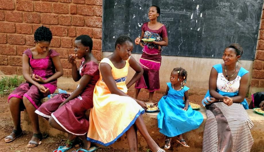 Thriving Tailor Vocational programme students, Burkina Faso, enjoying lunch after their graduation ceremony