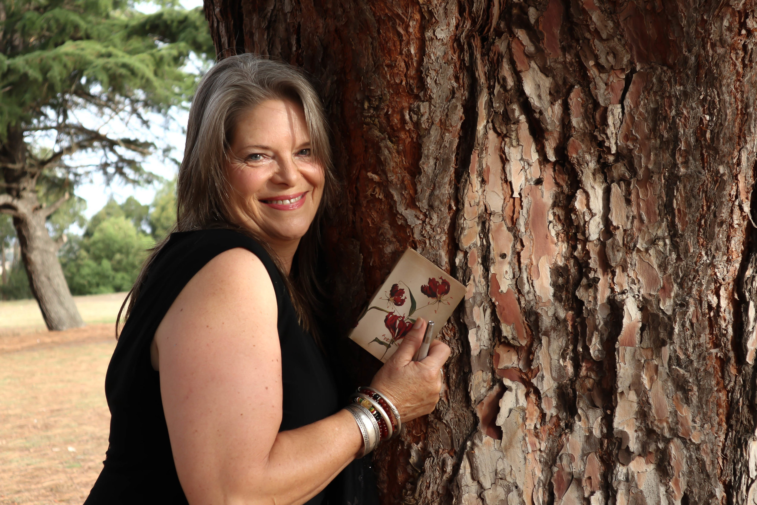 Linnet & notebook hugging tree.jpg