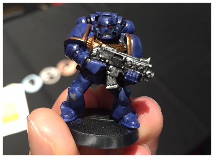 My first miniature - no brush control, thick application of paints.
