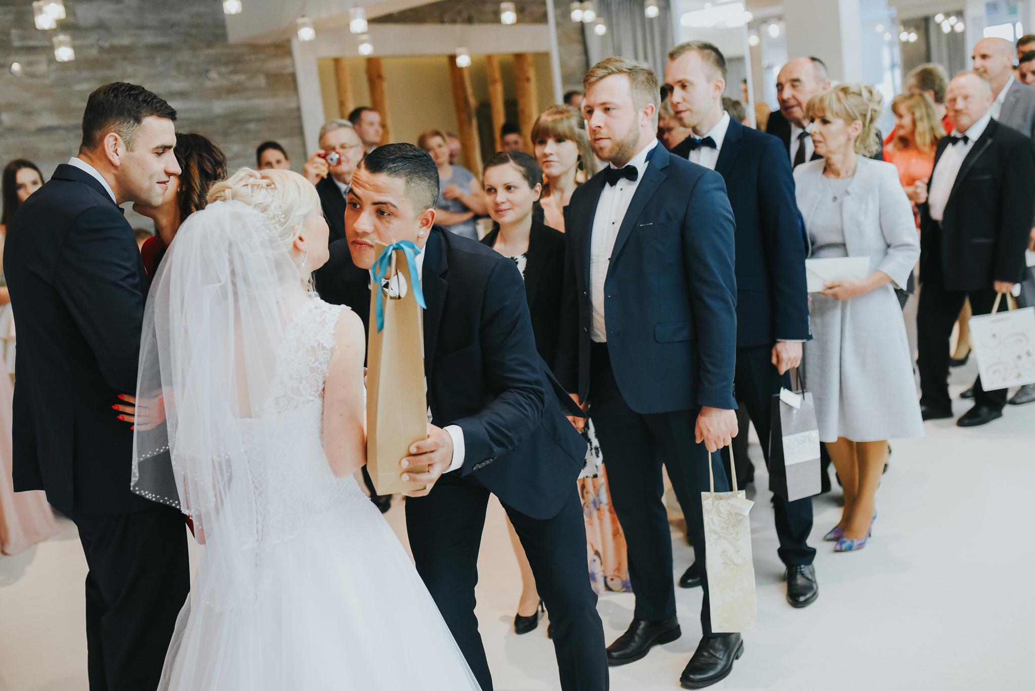 0521_Paulina&Bartosz________fotoreportaz_ze_slubu_sosnie_wesela_kaczory_deluxe_____fotografia_slubna_www_amfoto_pl_AMF_0622.jpg