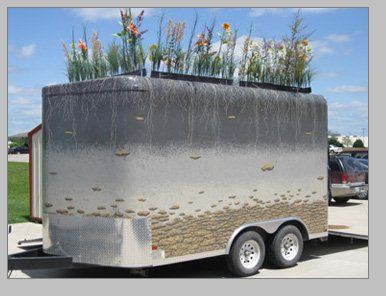 This fun, whimsical project is used to easily travel anywhere!  Showing adults, youth and school children how our natural world works has never been easier.  the plants on the roof of the trailer come off and store inside the trailer for travel.     The soil tunnel trailer, Miami County Conservation District
