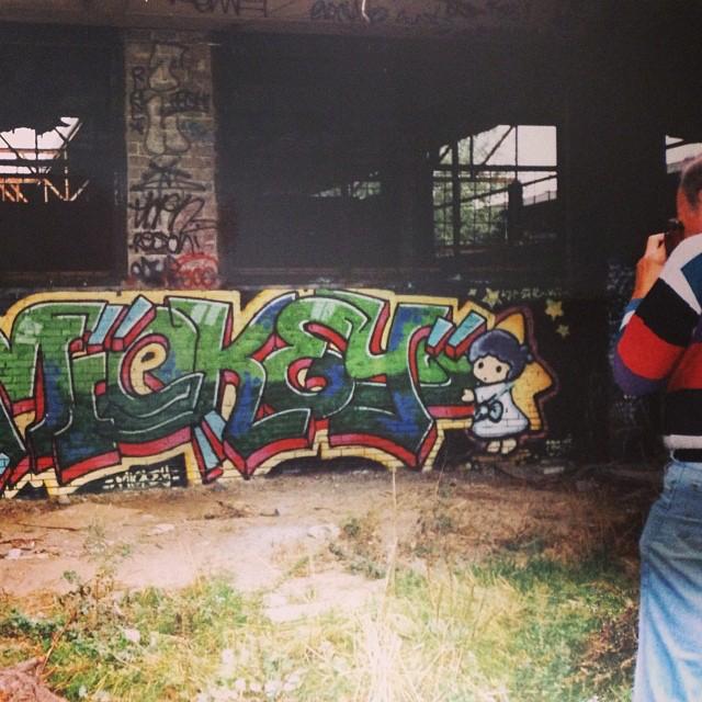 Groningen 1992.   James Prigroff  (Spraycan Art) photographing a Mickey piece.