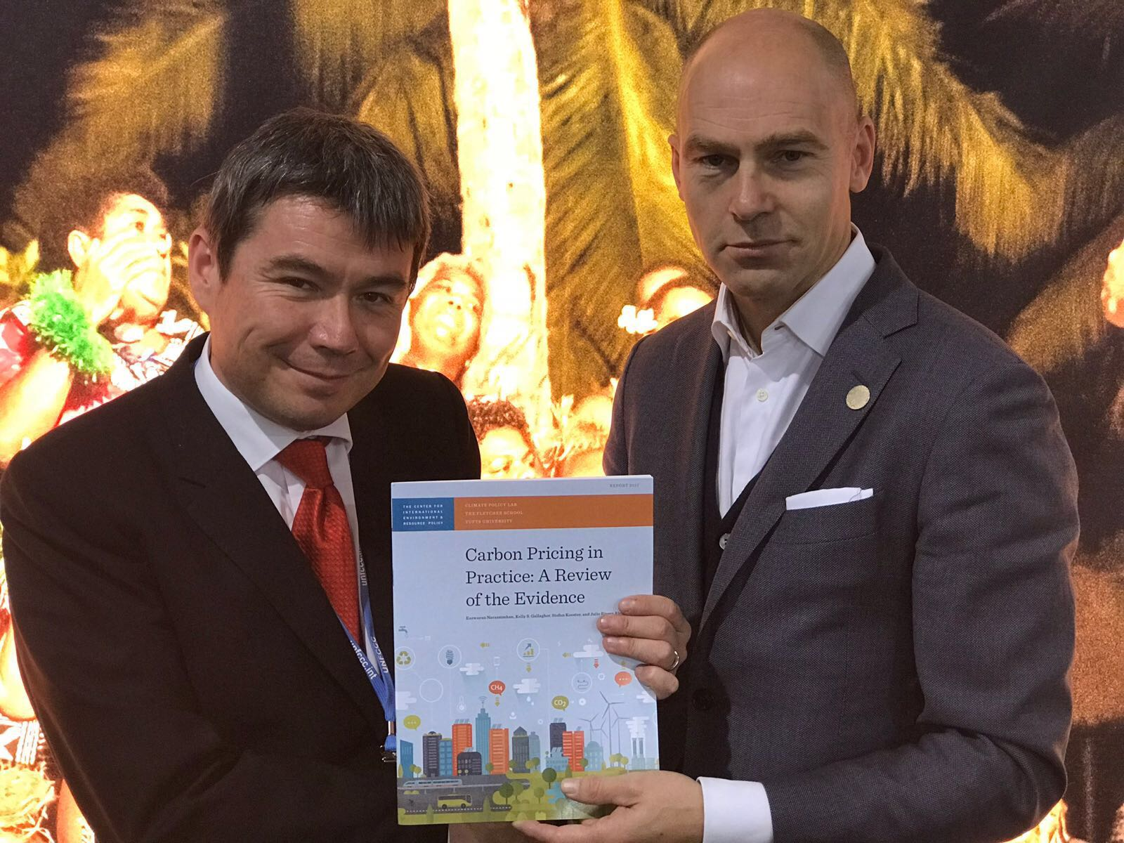 Professor of Practice, Patrick Verkooijen sharing CPL's Clean Energy Policy and Expanding Markets publication with Marcelos Mena, Minister of the Environment, Chile.