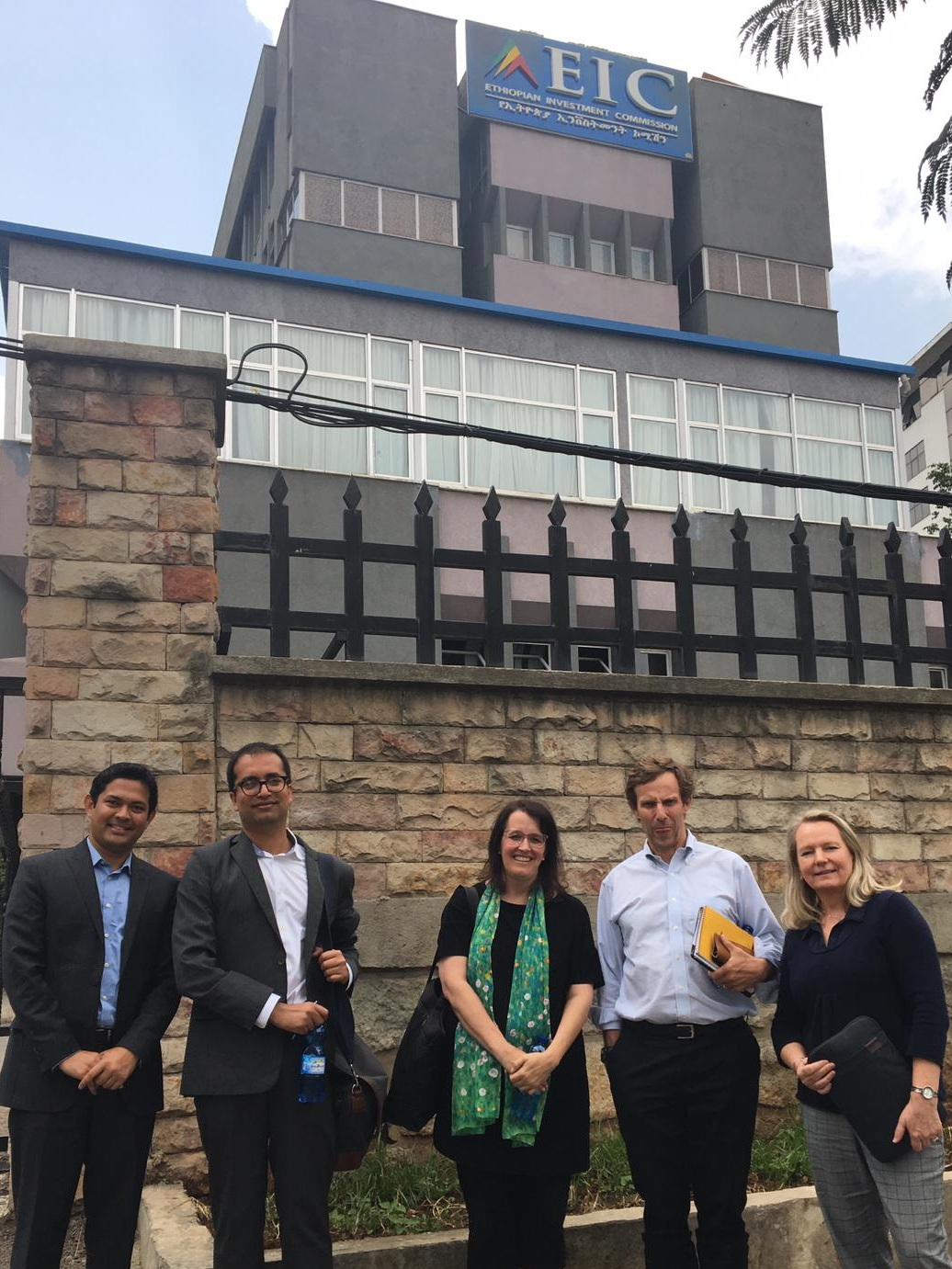 Predoctoral fellows Easwaran Narassimhan, Rishikesh Bhandary, Professor Kelly Sims Gallagher, Mike Northrup, and CIERP Associate Director Mieke van der Wansem in front of the Ethiopian Investment Commission in Addis Ababa, Ethiopia.