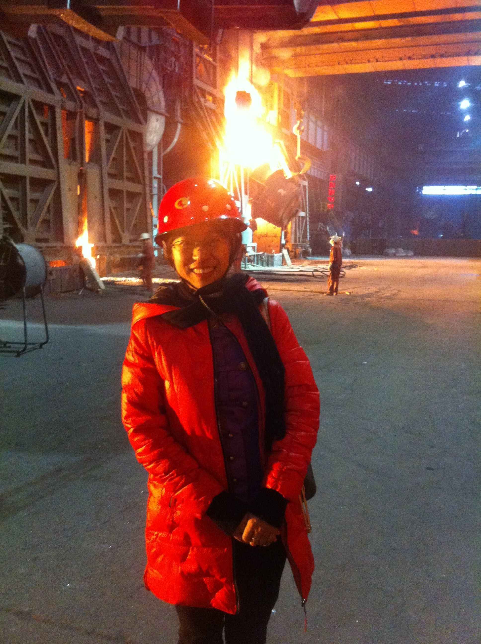 Pre-doctoral student, Fang Zhang, at a steel mill.