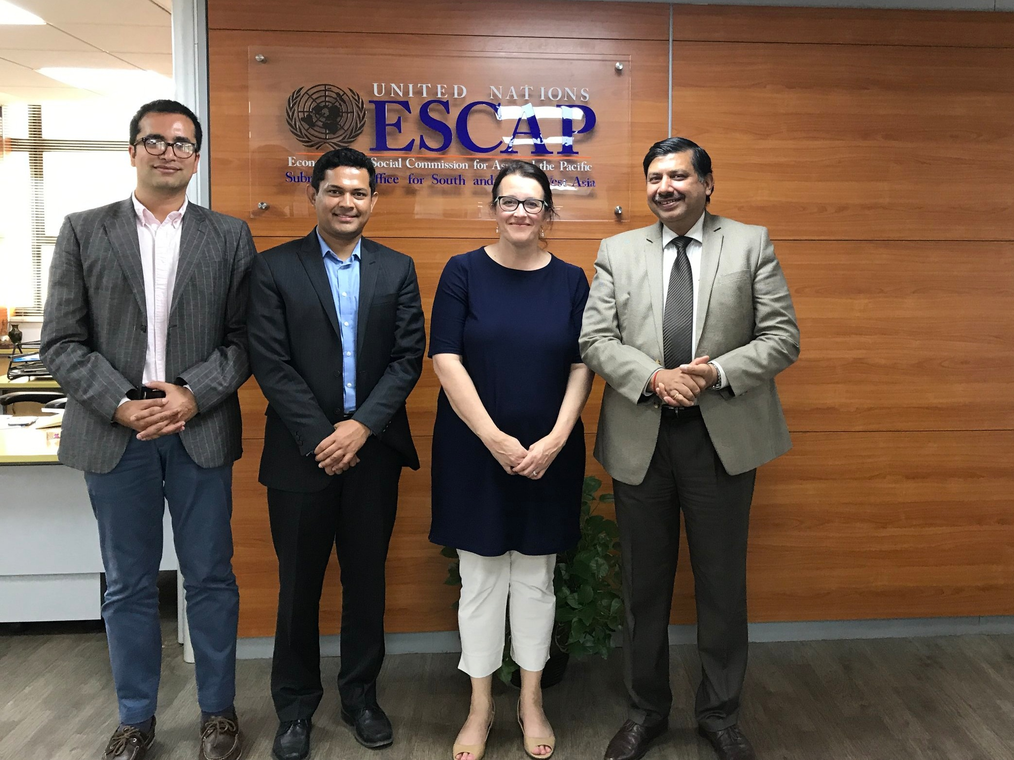 Professor Kelly Sims Gallagher and predoctoral students Rishikesh Bhandary and Easwaran Narassimhan visit with Nagesh Kumar, Director and Head of the South and South-West Asia office at United Nations ESCAP in India.