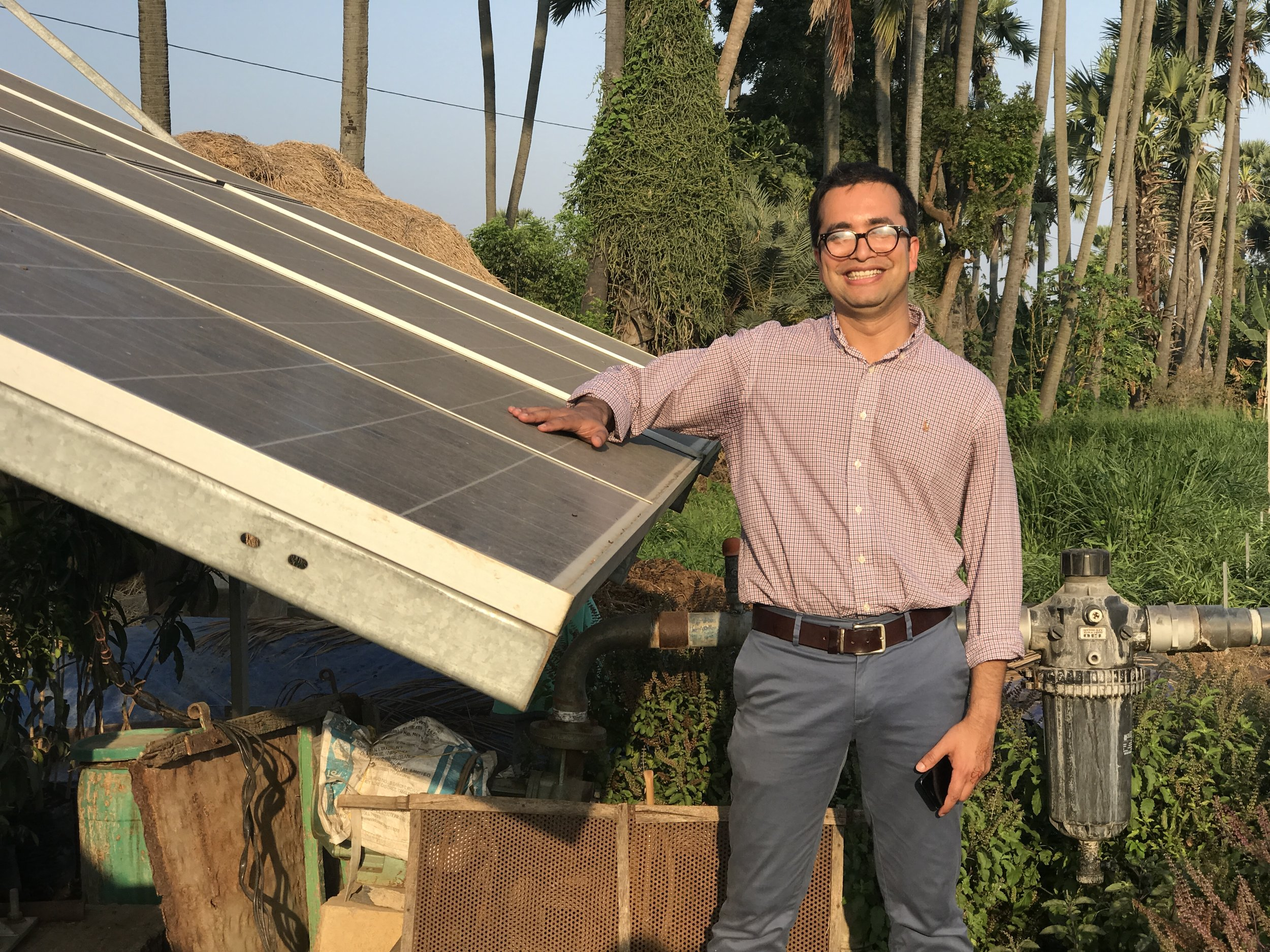 Pre-doctoral student, Rishikesh Bhandary, with solar panels in India.