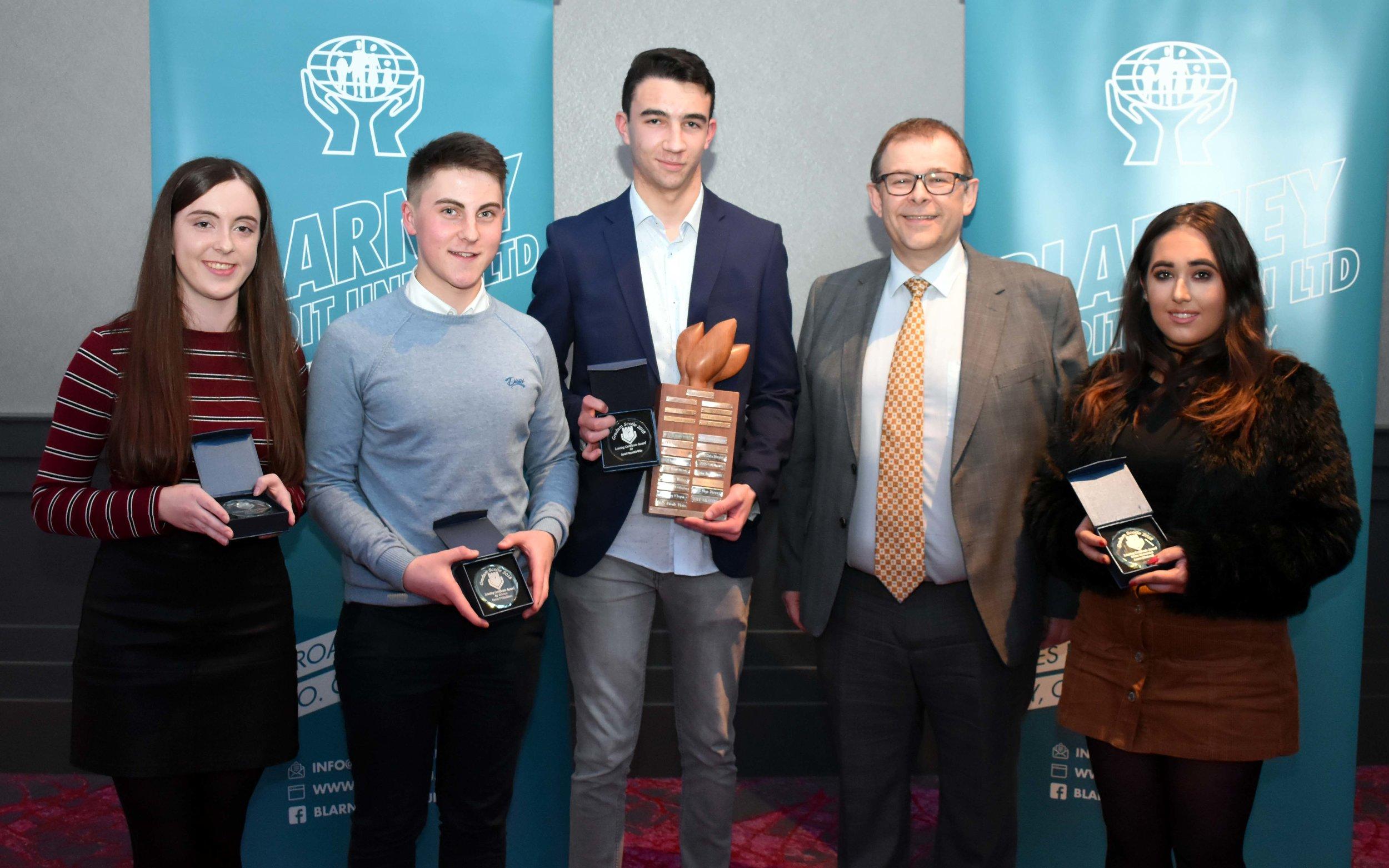 Senior Subject Award winners: Laoise Gavin (Chemistry), Denis O' Sullivan (Ag. Science), Daniel Fitzpatrick -White (Art), Laura O' Driscoll (Home Economics) (Pictured with Mr. Mark McGloughlin - BOM and Blarney Credit Union)