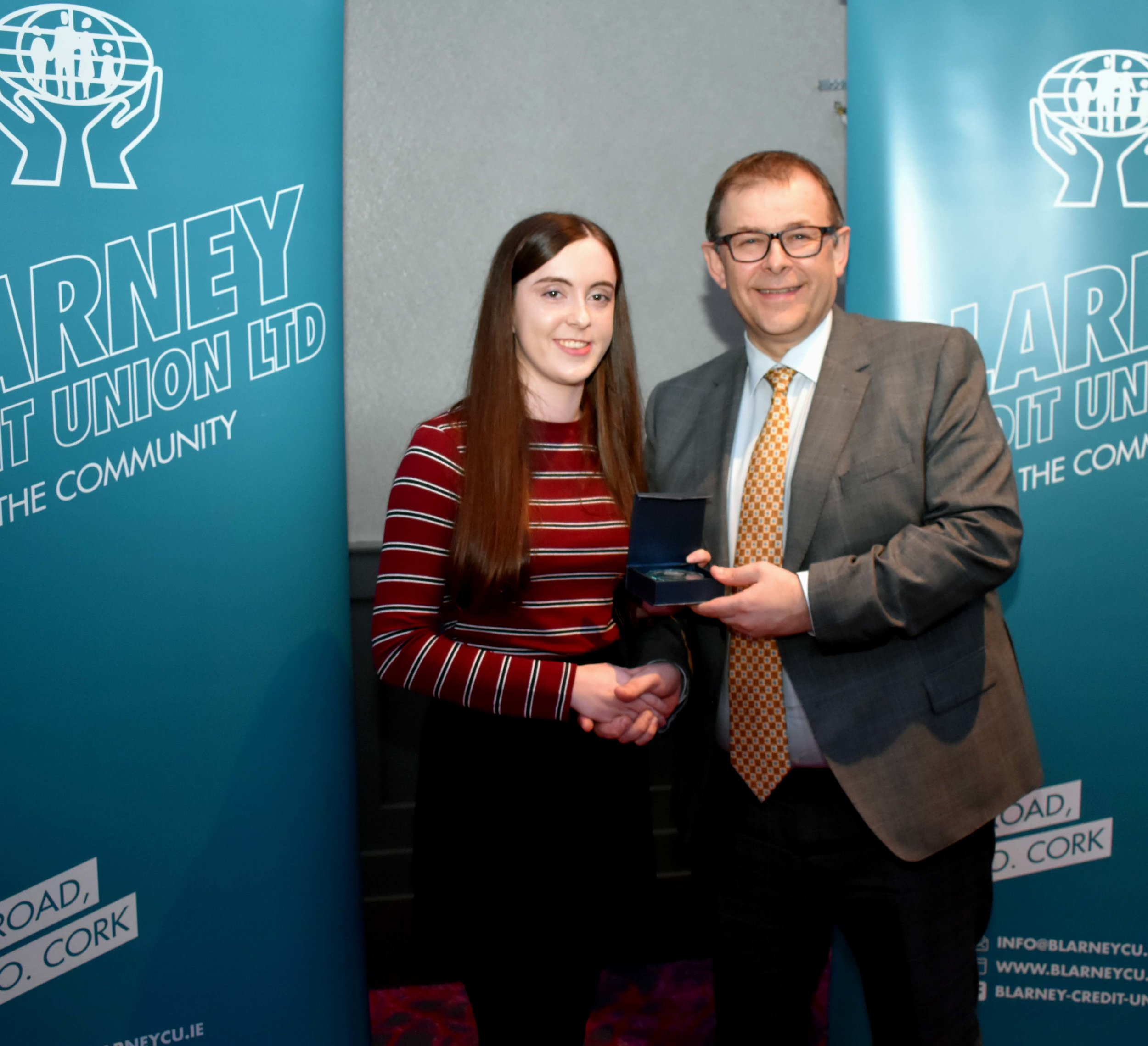 Laoise Gavin receiving the Gold Leaving Certificate Medal for achieving 625 points. (Pictured with Mr. Mark McGloughlin - BOM and Blarney Credit Union)
