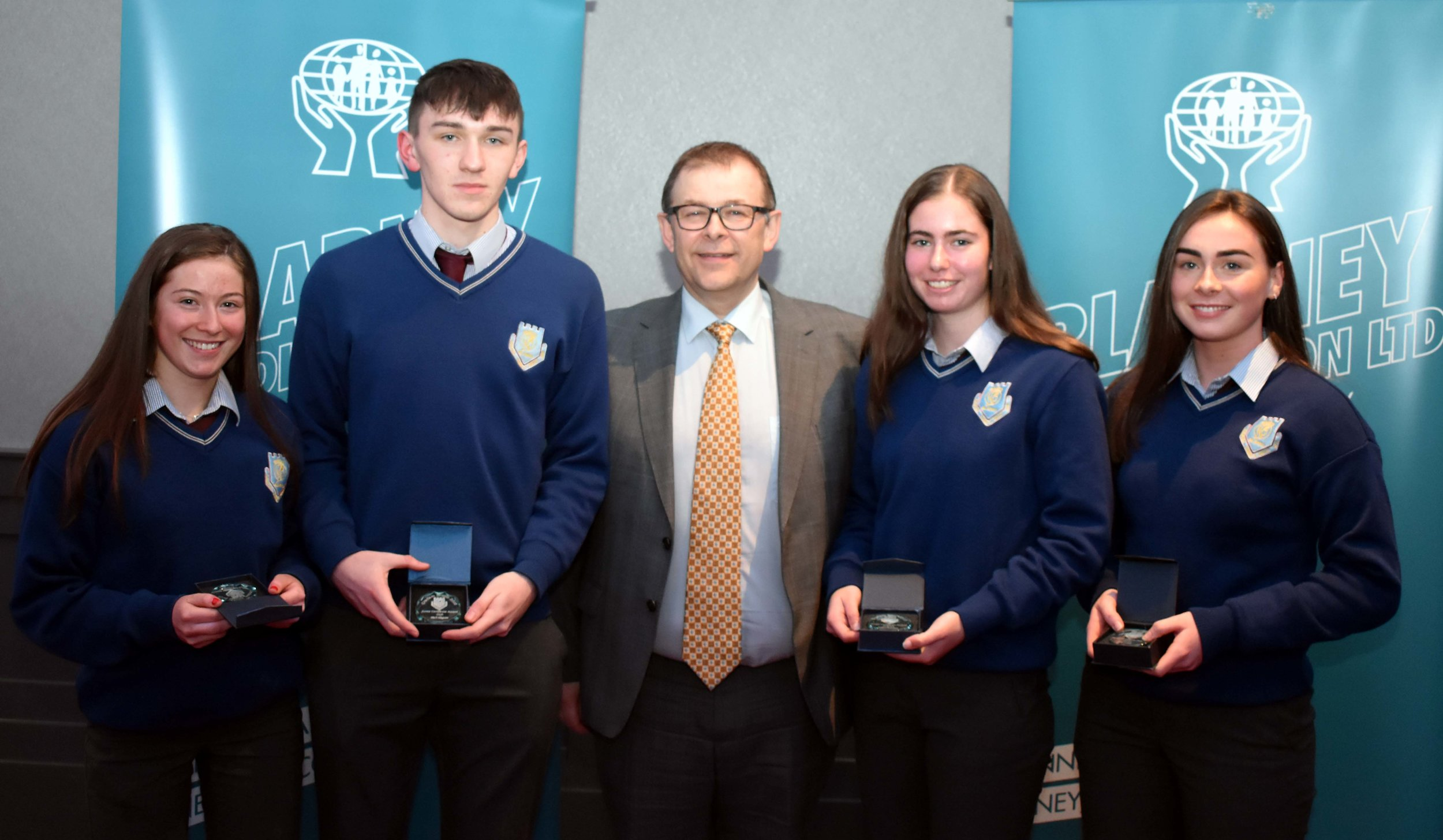 Junior Subject Award Winners: Emily Kelly (Science), Mark Maguire (Irish), Aideen Donovan (English) and Orla Cronin (Maths) (Pictured with Mr. Mark McGloughlin - BOM and Blarney Credit Union)