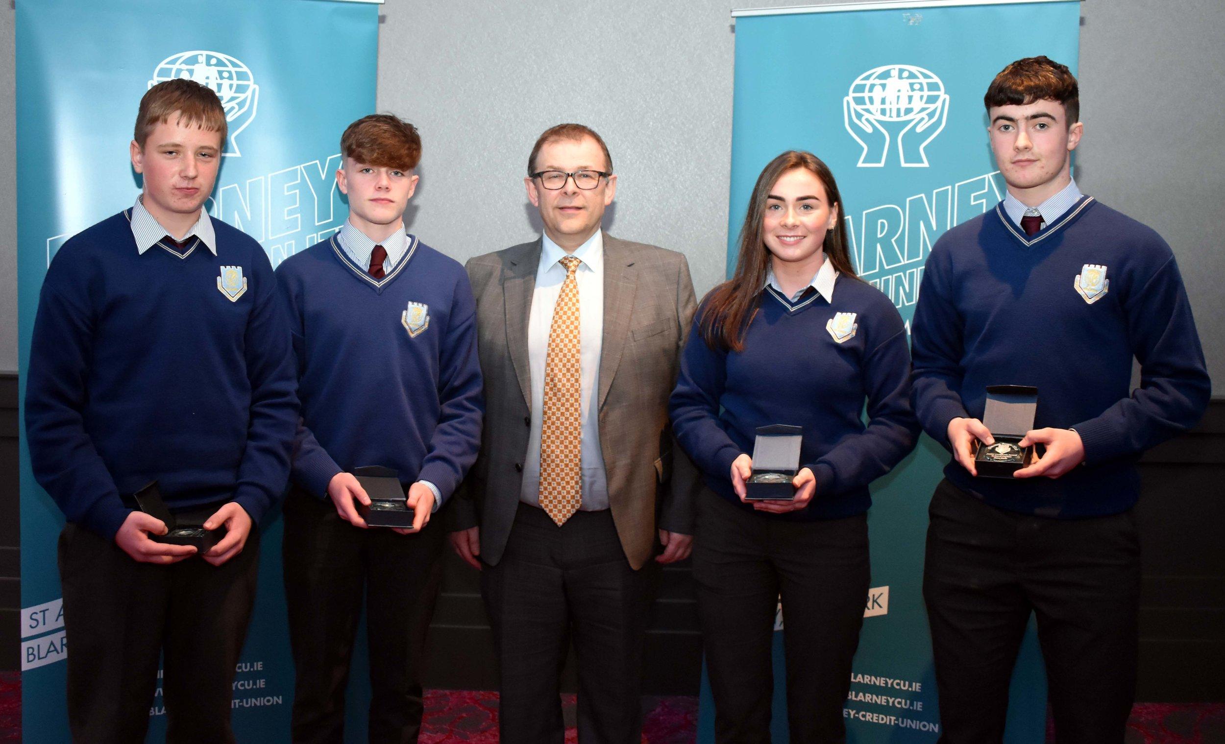 Junior Subject Award winners: Aidan Linehan (Metalwork), Ryan Daly (Music), Orla Cronin (Business Studies), Shane Roche (Technical Graphics) (Pictured with Mr Mark McGloughlin - BOM and Blarney Credit Union)