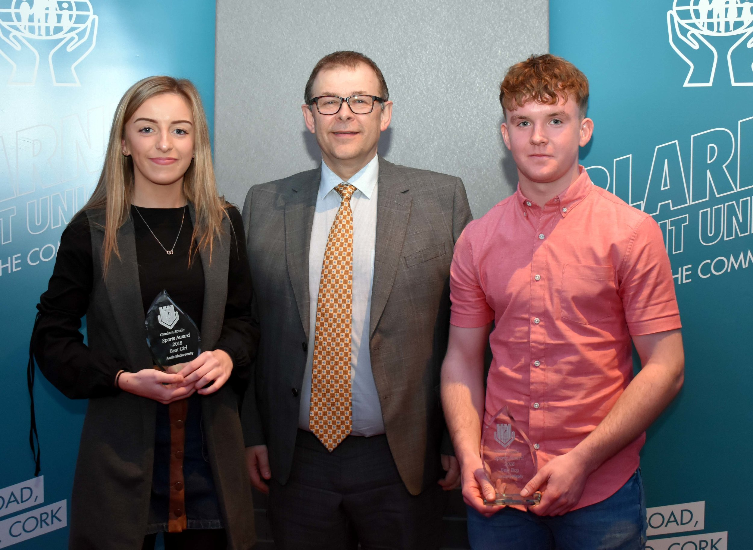 Sports Awards: Best Girl - Aoife Mc Sweeney and Best Boy - Paul Barry Murphy (Pictured with Mr. Mark McGloughlin - BOM and Blarney Credit Union)