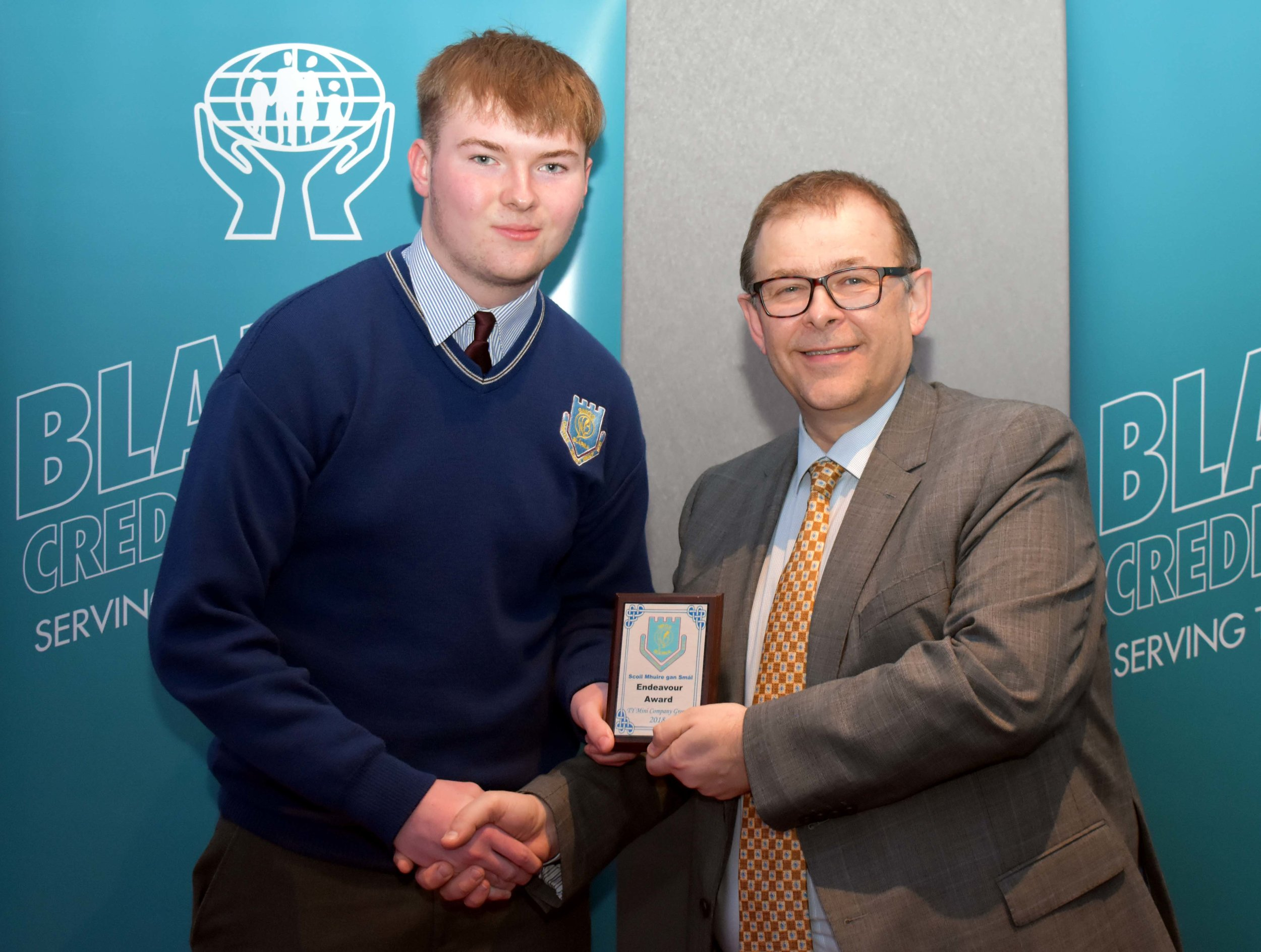TY Mini Company group 2017/18 were the receipents of an endeavour award for organising a very successful charity walk fundraiser for the Surgeon Noonan Project. Jack Crotty accepting the award on behalf of the group. (Pictured with Mr. Mark McGloughlin - BOM and Blarney Credit Union)