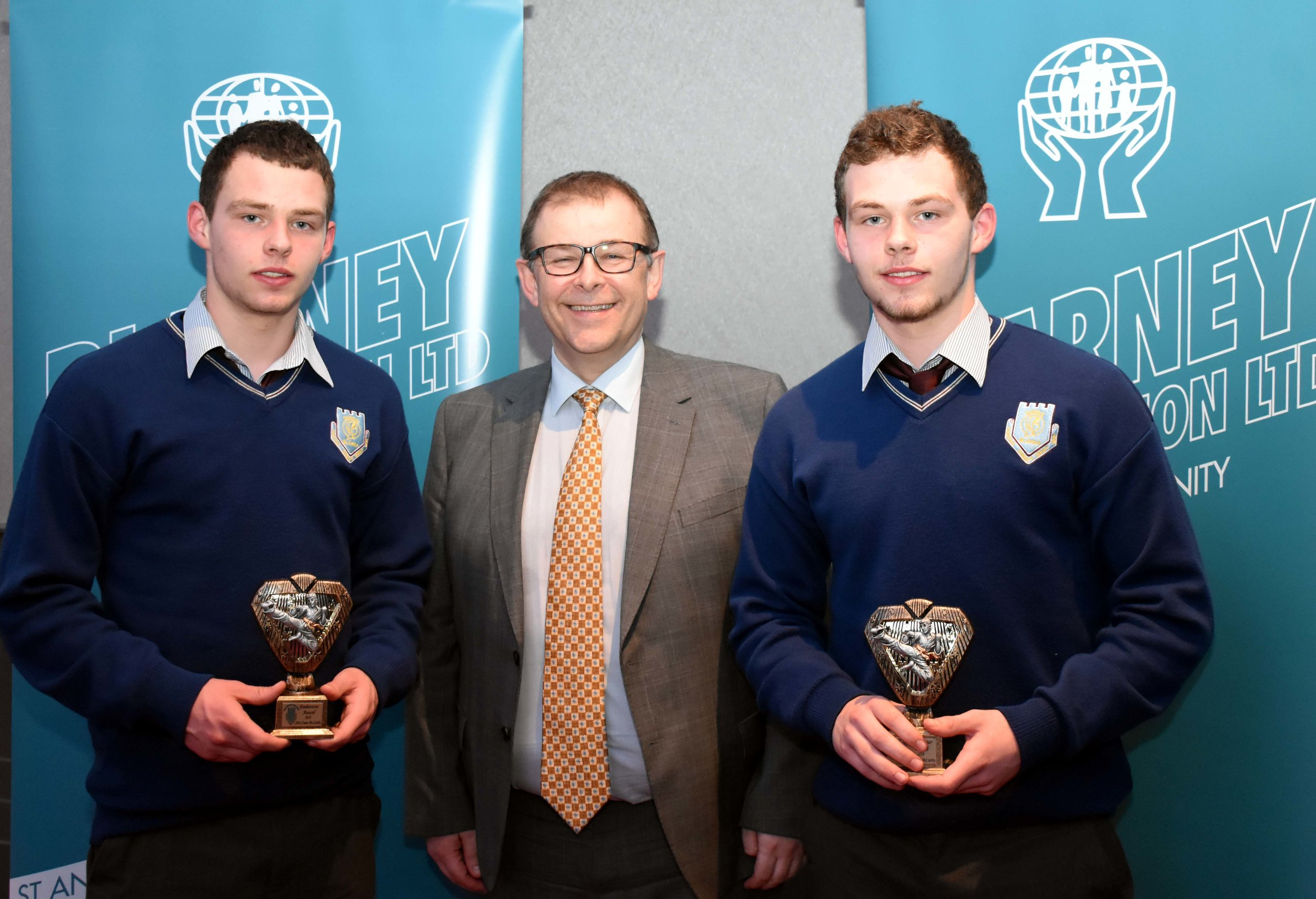- Chris and Seán Crean McCarthy receiving an endeavour award for representing Ireland in the European Karate Finals in Sochi, Russia. Seán won a silver medal and Chris came 5th in the same competition. (Pictured with Mr. Mark McGloughlin - BOM and Blarney Credit Union)