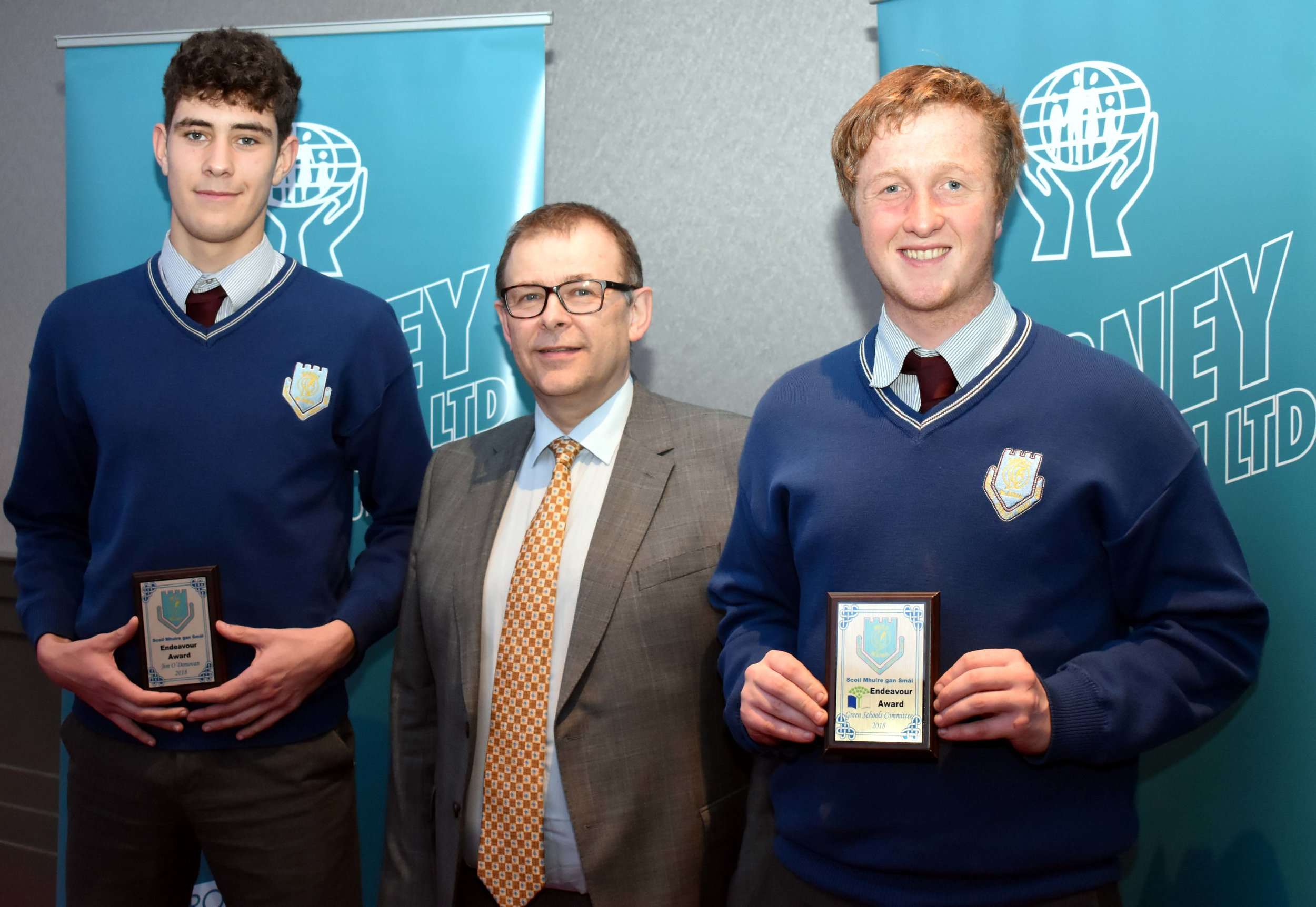 Jim O' Donovan and Seanán Jones receiving an endeavour award for volunteering to travel to Lourdes last summer with Cloyne Lourdes Group. (Pictured with Mr. Mark McGloughlin - BOM and Blarney Credit Union)