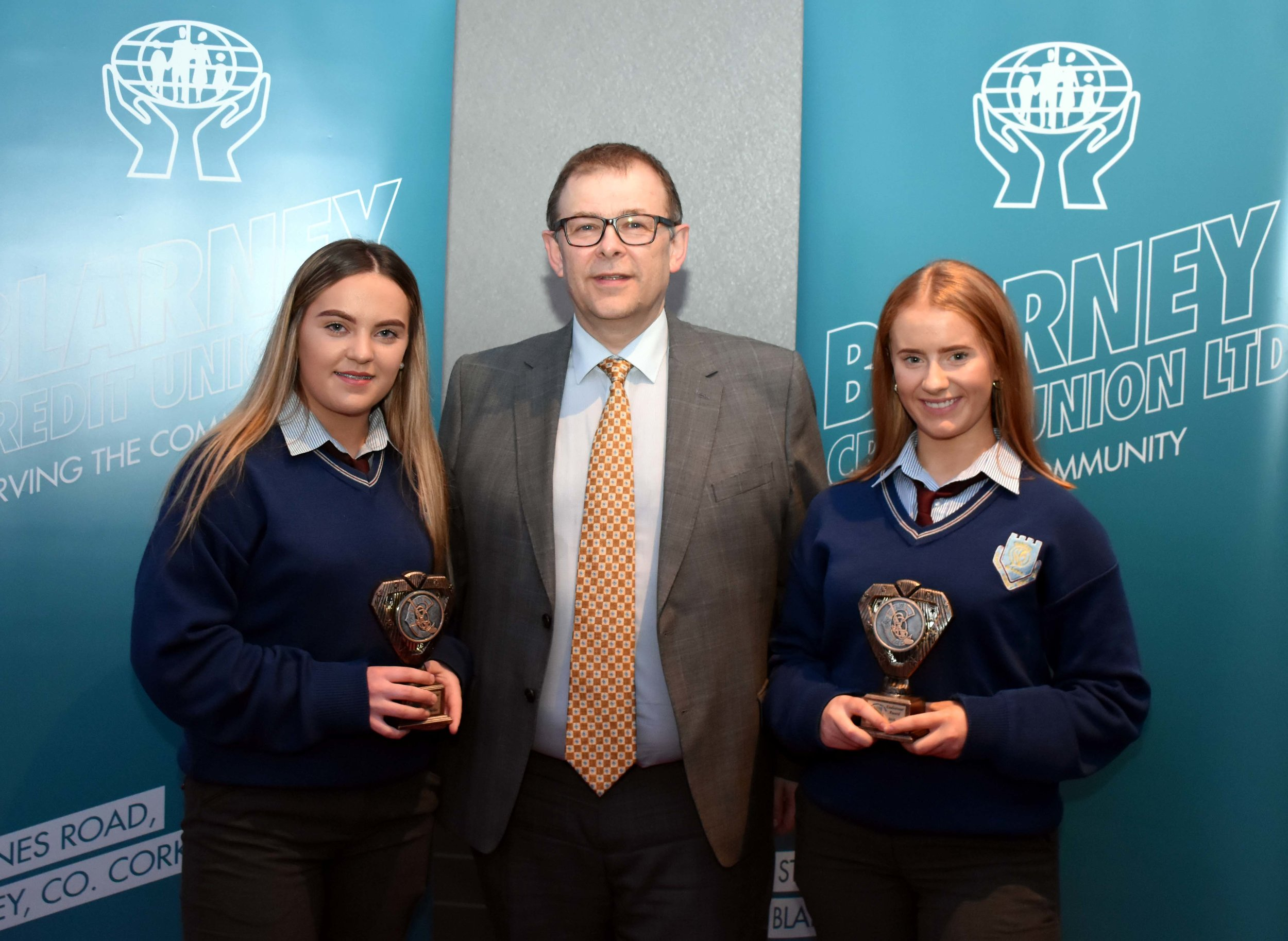 Emily Buckley and Orla Cremen receiving an endeavour award for winning a Minor All Ireland with Cork Camogie. (Pictured with Mr. Mark McGloughlin - BOM and Blarney Credit Union)