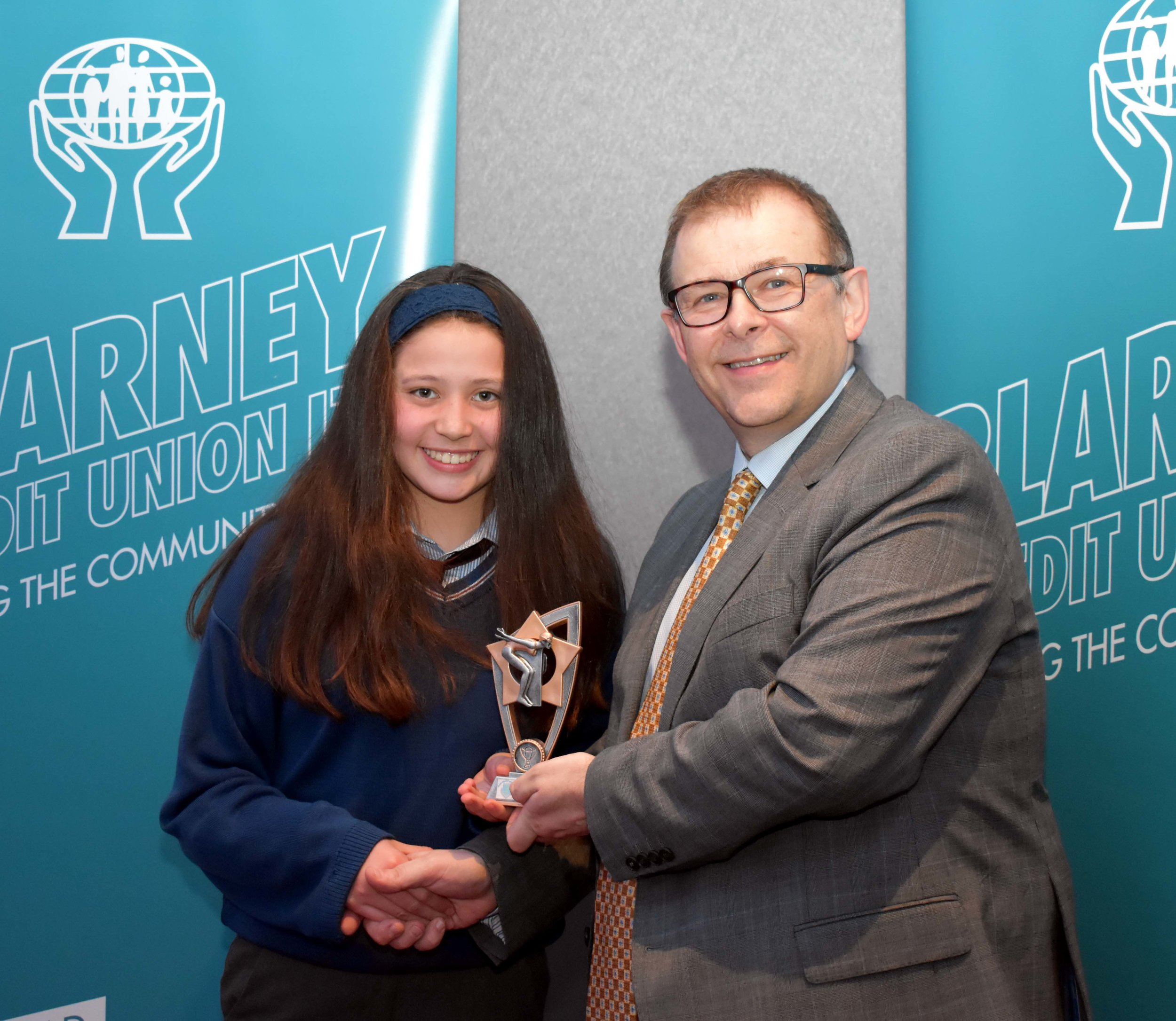 Hannah O' Shea receiving an endeavour award for competing in the Swimming Nationals in the summer , winning 5 Gold medals, 1 Silver and 1 Bronze. (Pictured with Mr. Mark McGloughlin - BOM and Blarney Credit Union)