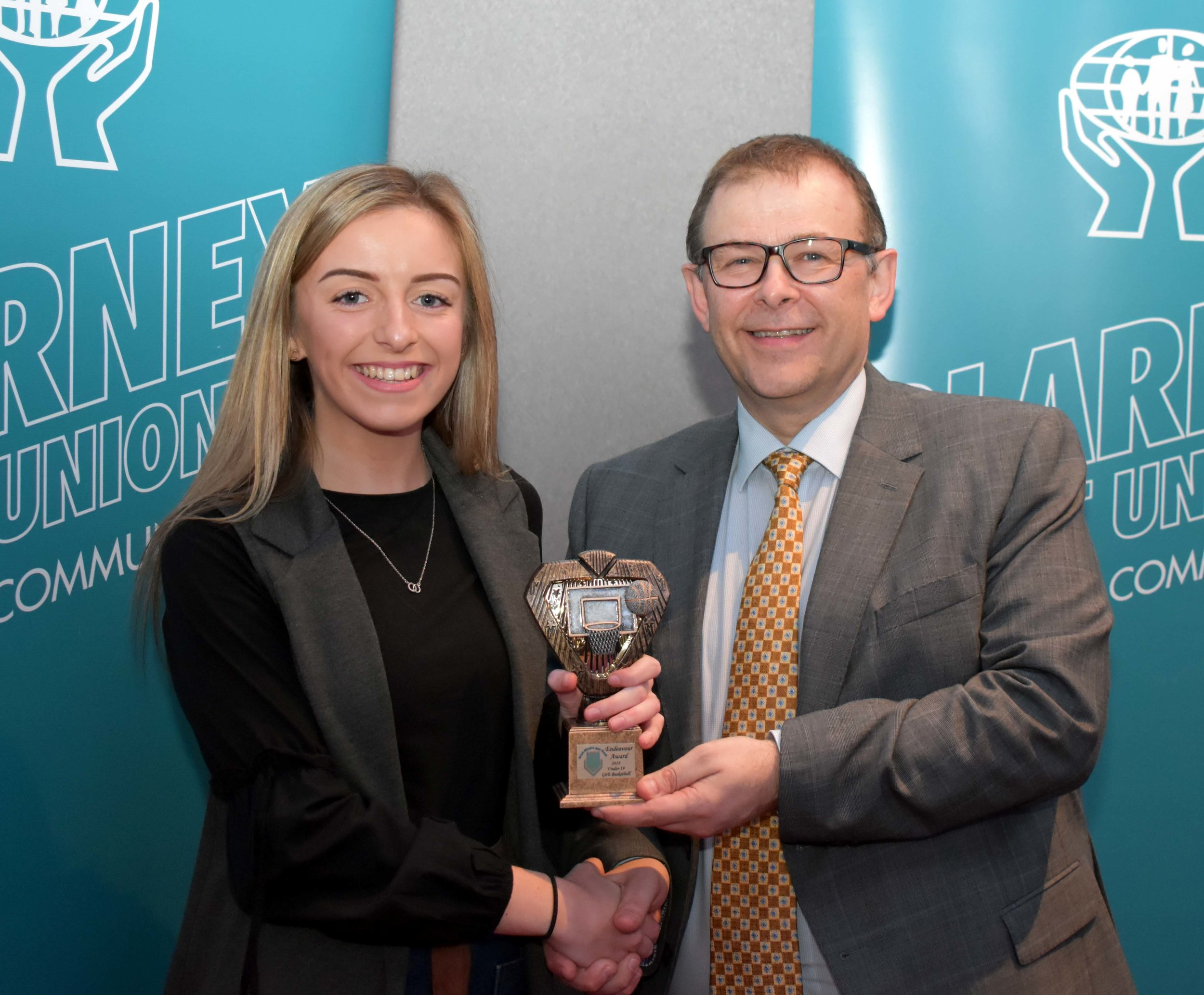 U19 Girls Basketball Team receiving an endeavour award for reaching the All Ireland. Captain Aoife McSweeney accepting the award on behalf of the team. (Pictured with Mr. Mark McGloughlin - BOM and Blarney Credit Union)