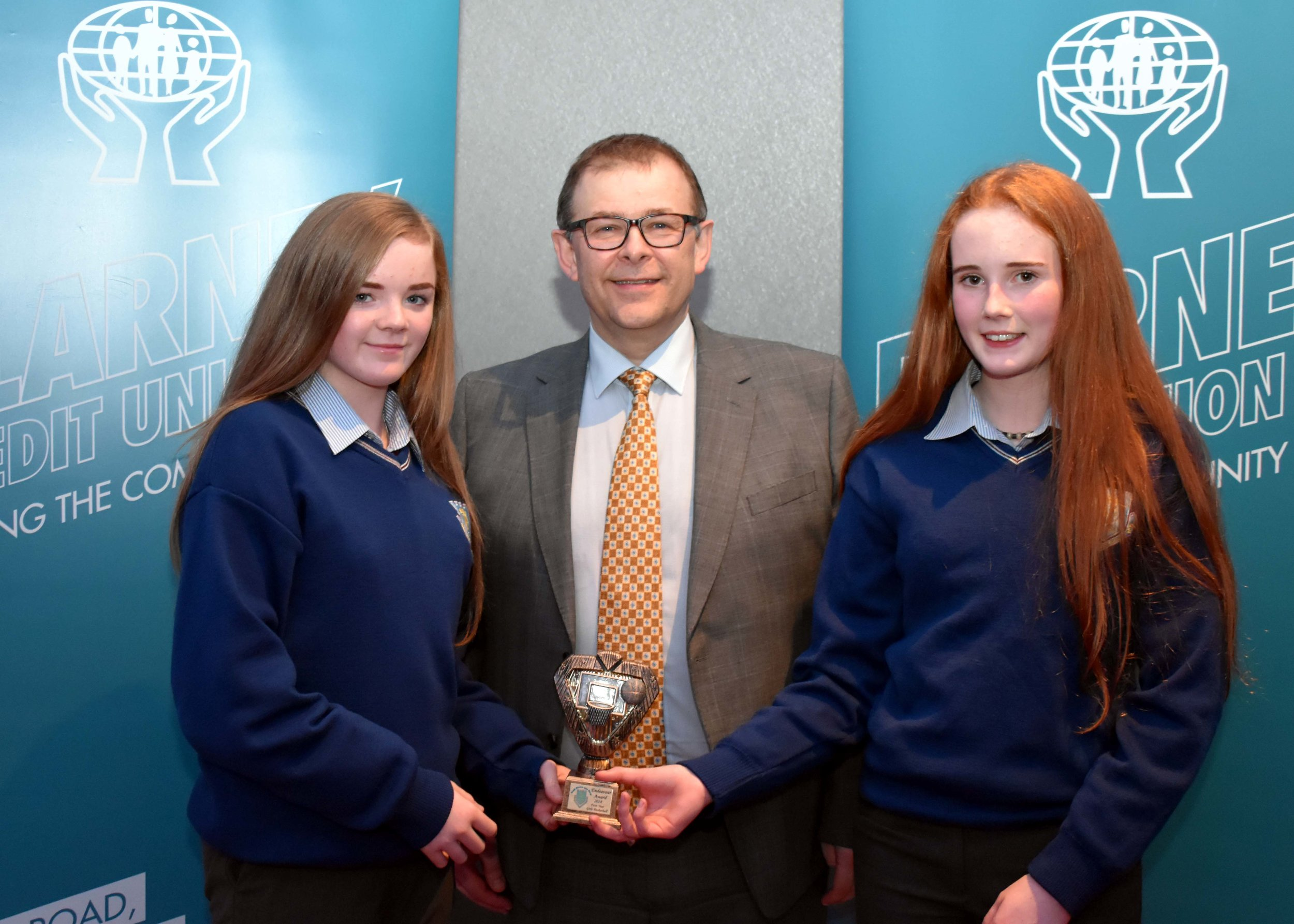 First Year Girls Basketball Team receiving an endeavour award for reaching the All Ireland. Joint captains Saoirse Breen and Orla Humphries are accepting the award on behalf of the team. Saoirse also won a Basketball All Ireland Final with her club Brunell. (Pictured with Mr. Mark McGloughlin - BOM and Blarney Credit Union)