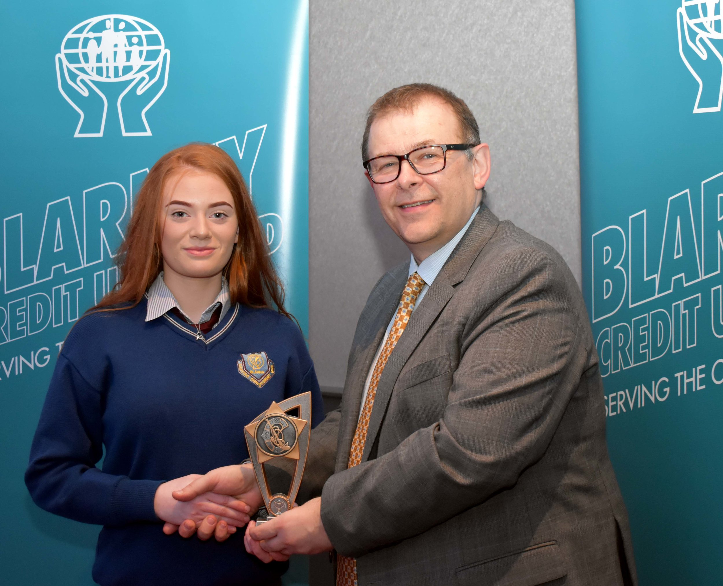 U15 Camogie Team receiving an endeavour award after having won All Ireland 7s in 2017. Team Captain Danielle Hendley accepting the award on behalf of the team. (Pictured with Mr. Mark McGloughlin - BOM and Blarney Credit Union)