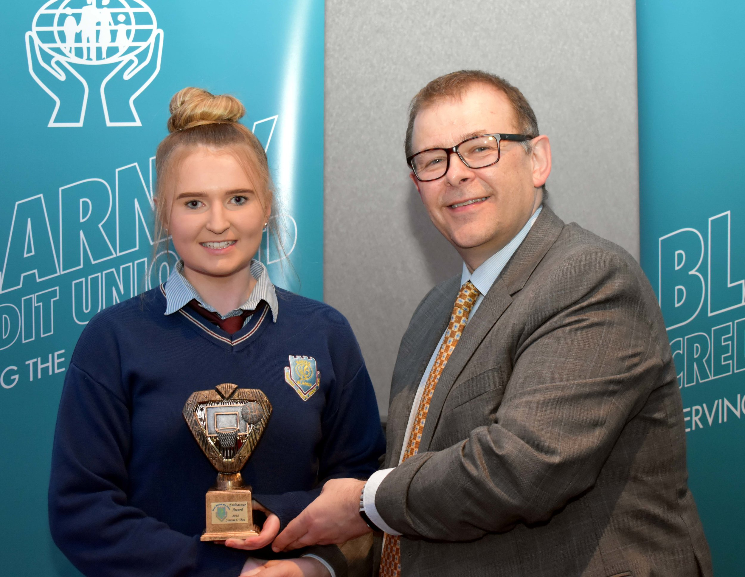 Simone O' Shea receiving an endeavour award for representing Ireland at the European 3x3 U18 Women's Basketball Championships held in France. (Pictured with Mr. Mark McGloughlin - BOM and Blarney Credit Union)