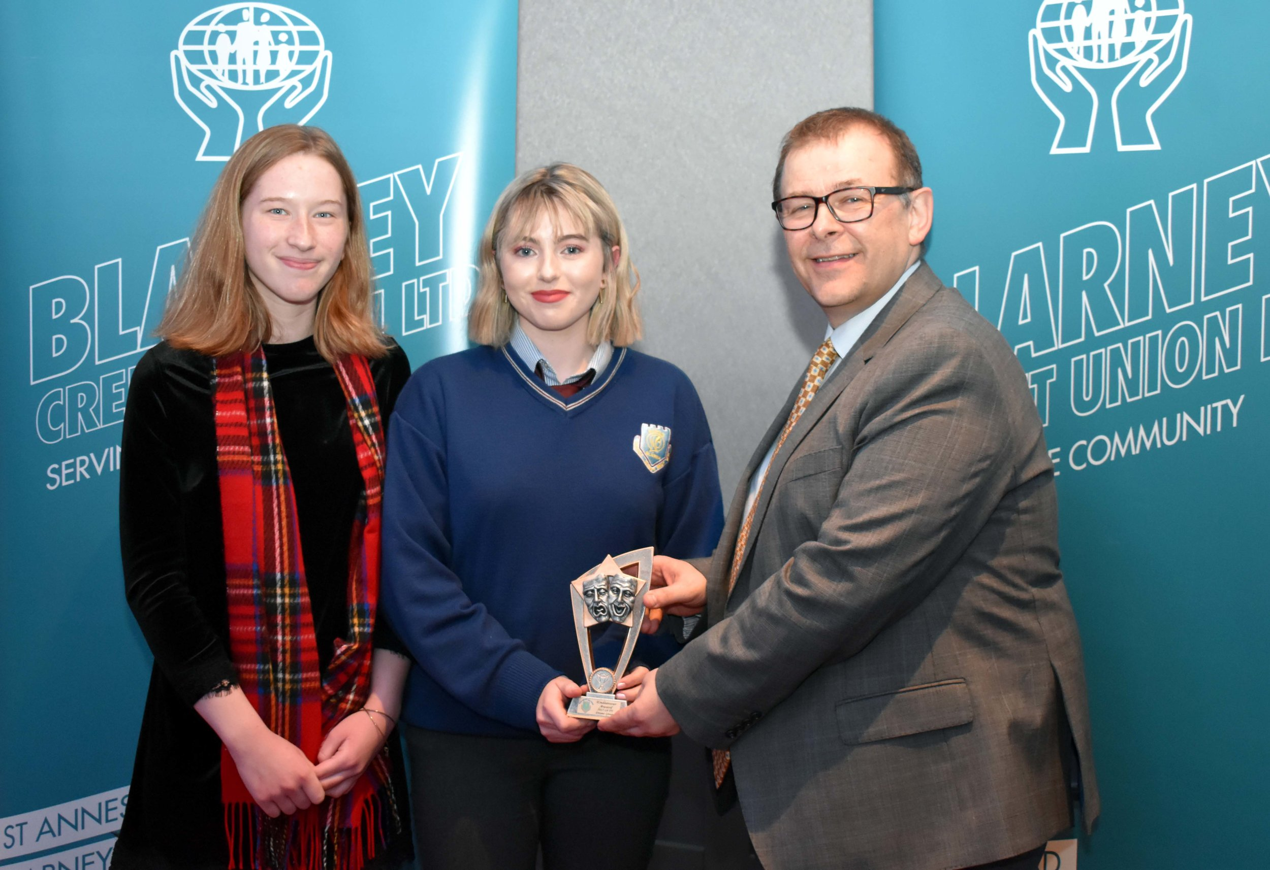 TY Drama Group 2017/18 receiving an endeavour award for reaching the Runner Up place in the All Ireland Final in Mullingar with their play written by Anna O' Connor and Abby Leahy, seen here accepting the award on behalf of the group. (Pictured with Mr. Mark McGloughlin - BOM and Blarney Credit Union)