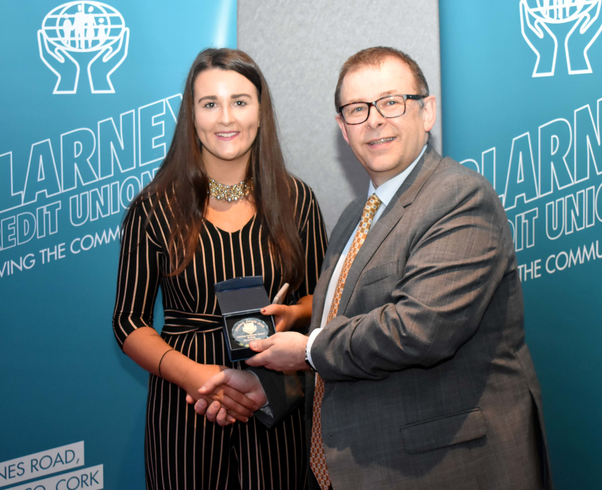 Senior Subject Award winner: Michelle Casey (Biology) (Pictured with Mr. Mark McGloughlin - BOM and Blarney Credit Union)