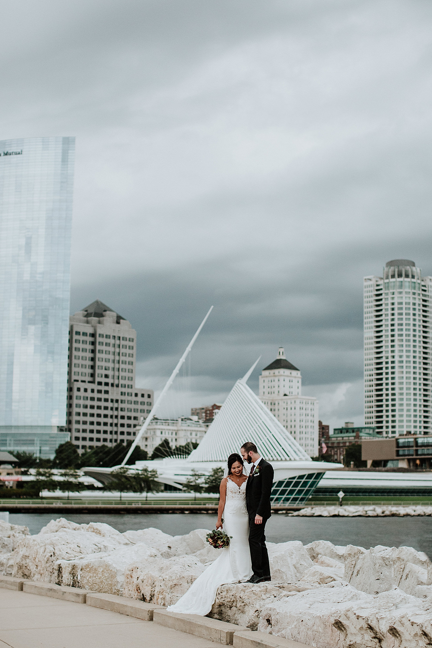 Bride and groom wedding photo with  Milwaukee skyline