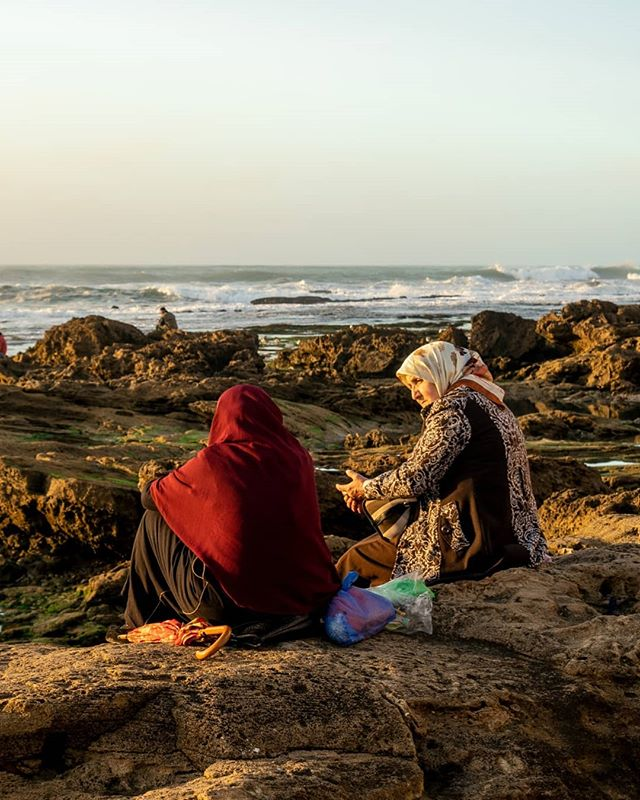 Two women on the outskirts of Essaouria, probably discussing the possibility of extraterrestrial life on the moon of saturn called titan. Or maybe it's a recipe for some dank tajine.