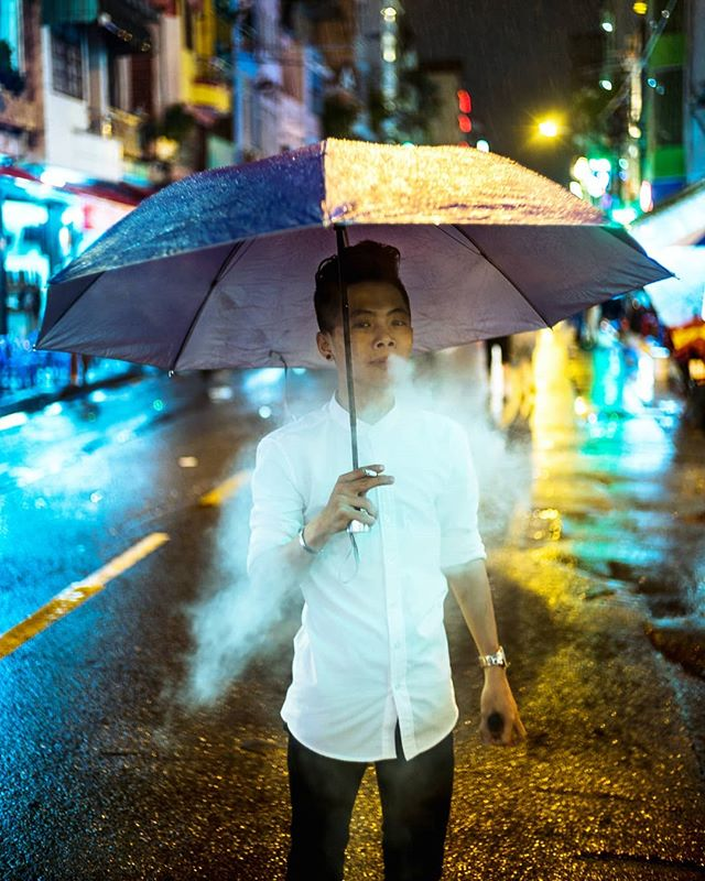 A Vietnamese dude working the streets, trying to get people to come to a night club. Definitely fit the part pretty well. Kinda jealous of his unbrella. Don't think I've ever taken one with me on any trip... Definitely regretted it a few times.