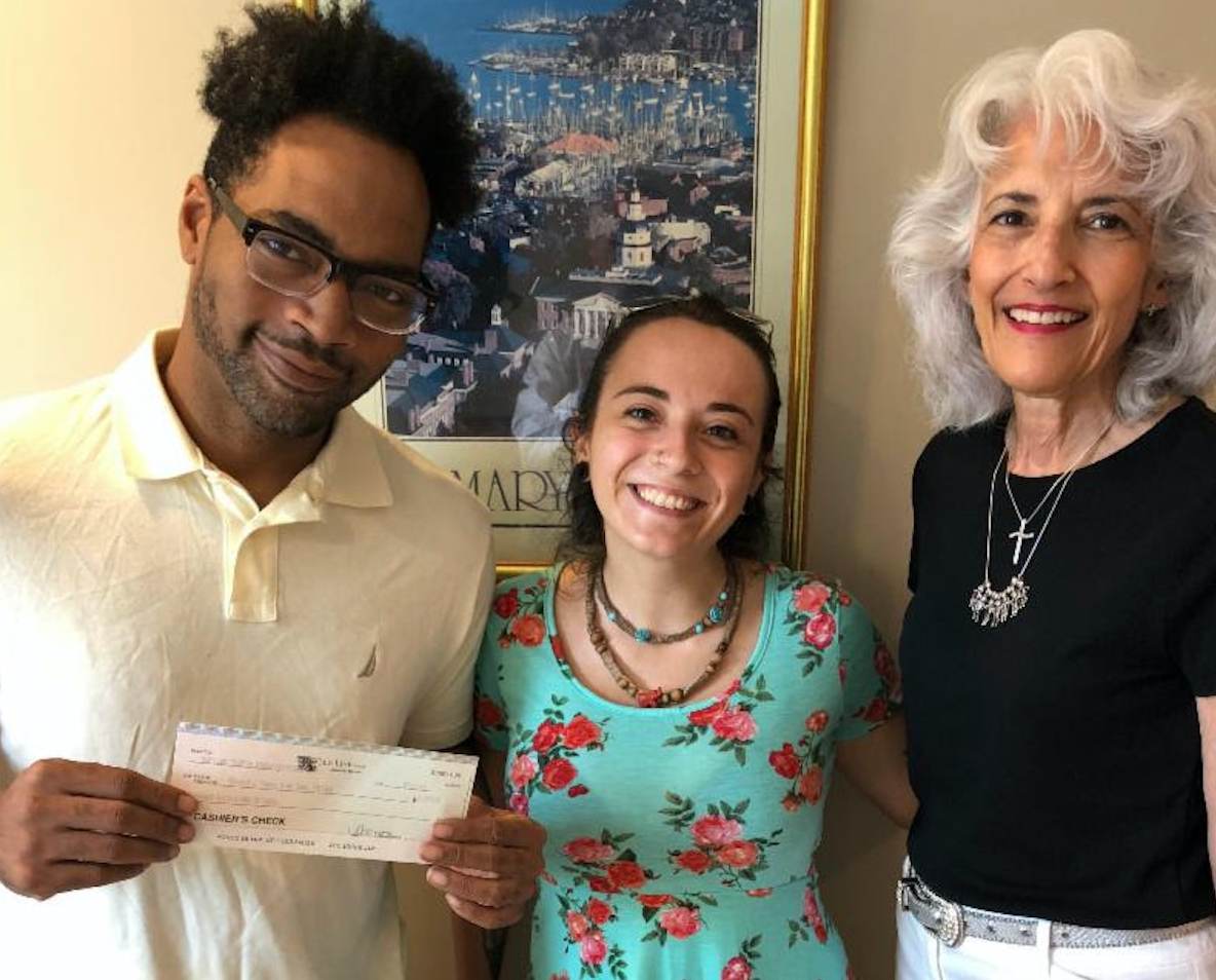 Photo: Vincent with Light House Employment and Training Advocate, Britnee Daniel, and Maryland Tourism Education Foundation, Inc. Executive Director, Roseanne Souza.