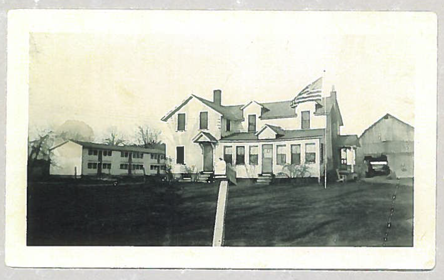 Superior's original office on the farm, complete with chicken coops and barn, in the 1940's.