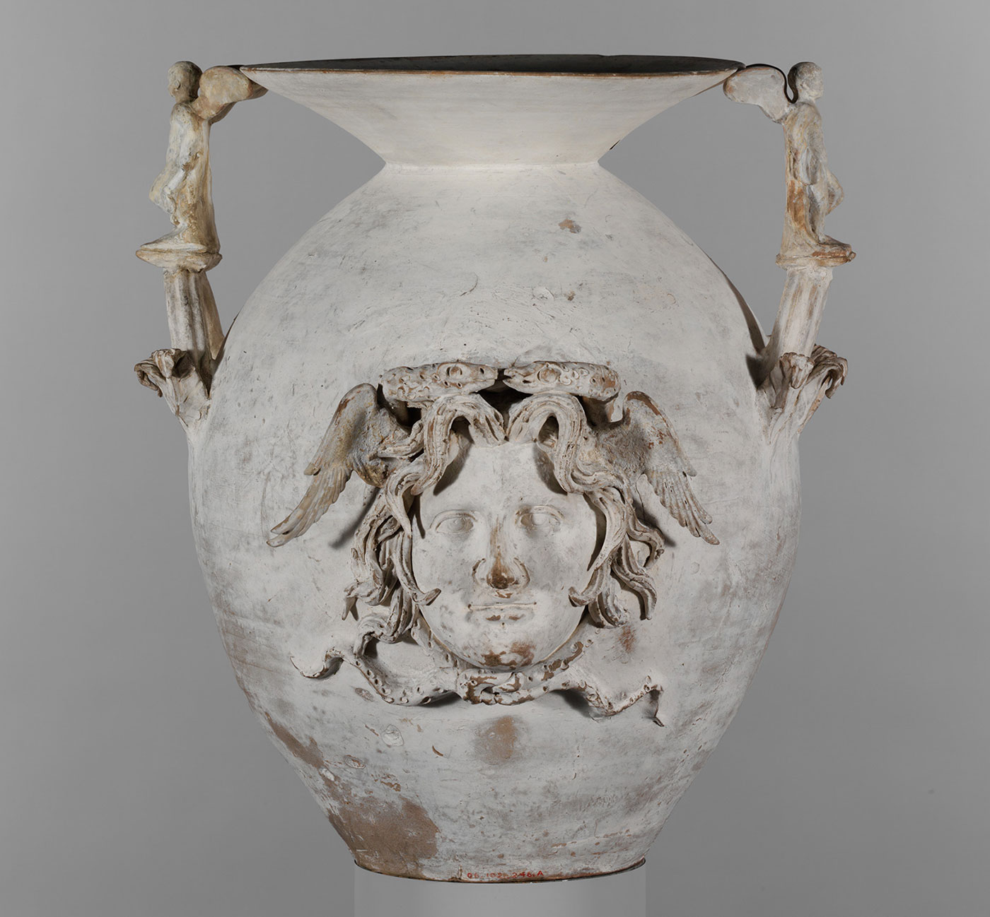 Terracotta two-handled funnel vase with Medusa head (Greek, South Italian, Apulian, Canosan, Early Hellenistic, late 4th–early 3rd century BCE), terracotta, height: 30 3/4 inches; diameter: 17 5/16 inches (courtesy the Metropolitan Museum of Art, Rogers Fund, 1906) (Image from  Hyperallergic article )